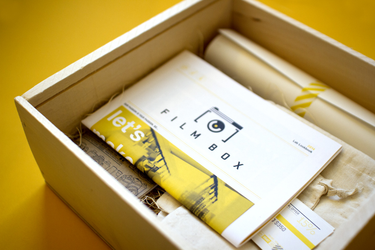 Film Box mini newspaper and poster rolled up and taped inside of promotional marketing mailer.