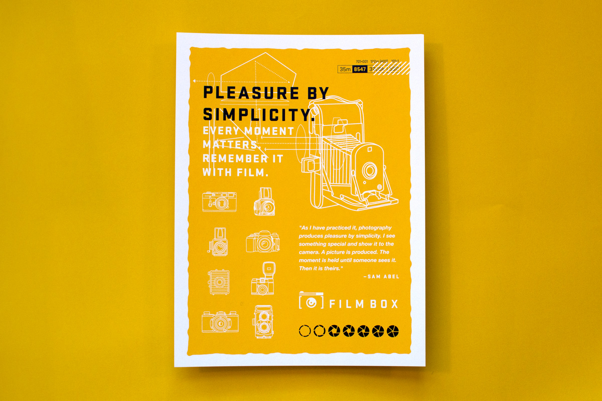 """Silk screen printed poster design, given away included in the promotional box mailer packaging, features two color print black and gold on white paper. Old camera illustrations and big clean modern headline typography reads """"Pleasure by Simplicity."""" Film Box logo and quote along the bottom."""