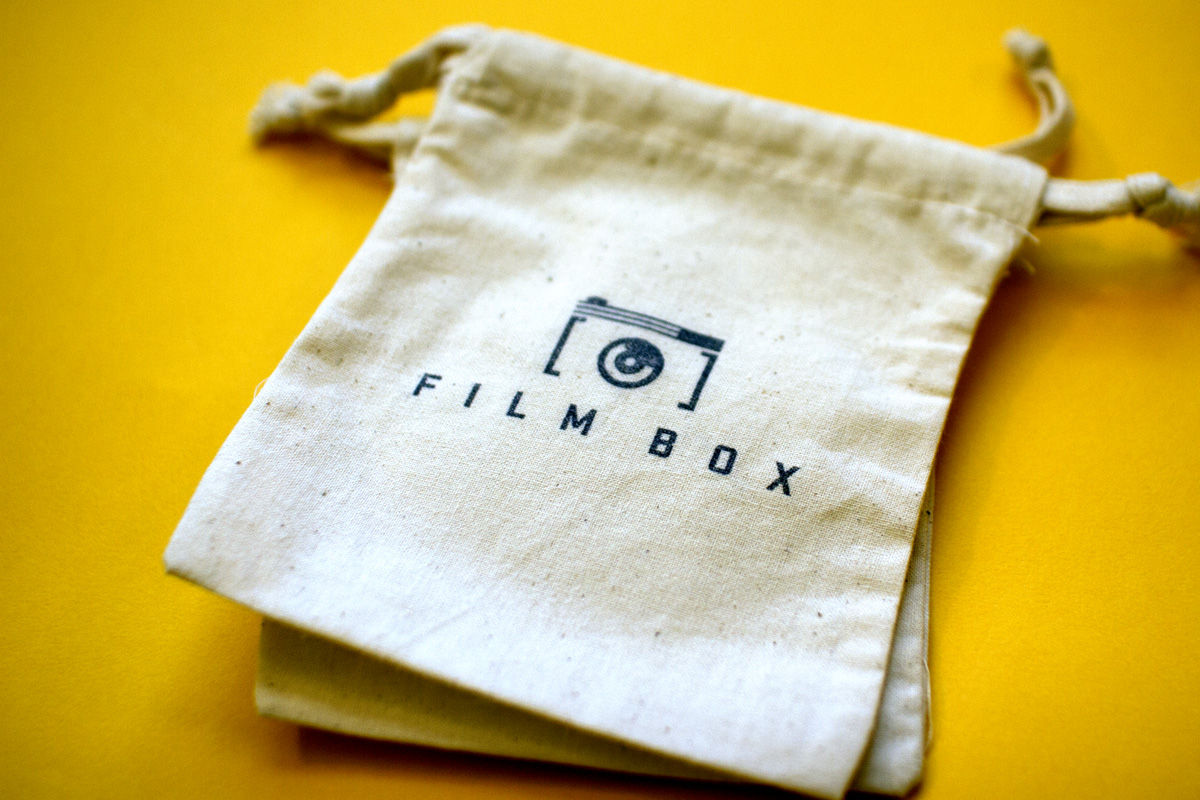 Medium drawstring cotton linen bag for film canisters, a giveaway for Film Box, with hand stamped logo on the front.