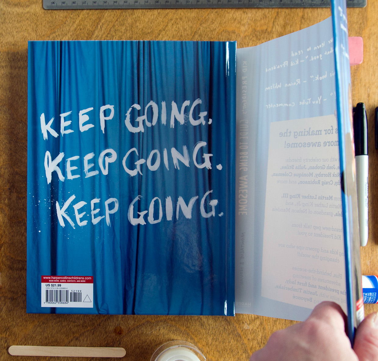 Keep Going brush lettering by hand on hardcover back design of kid president book underneath the dust jacket french fold flap