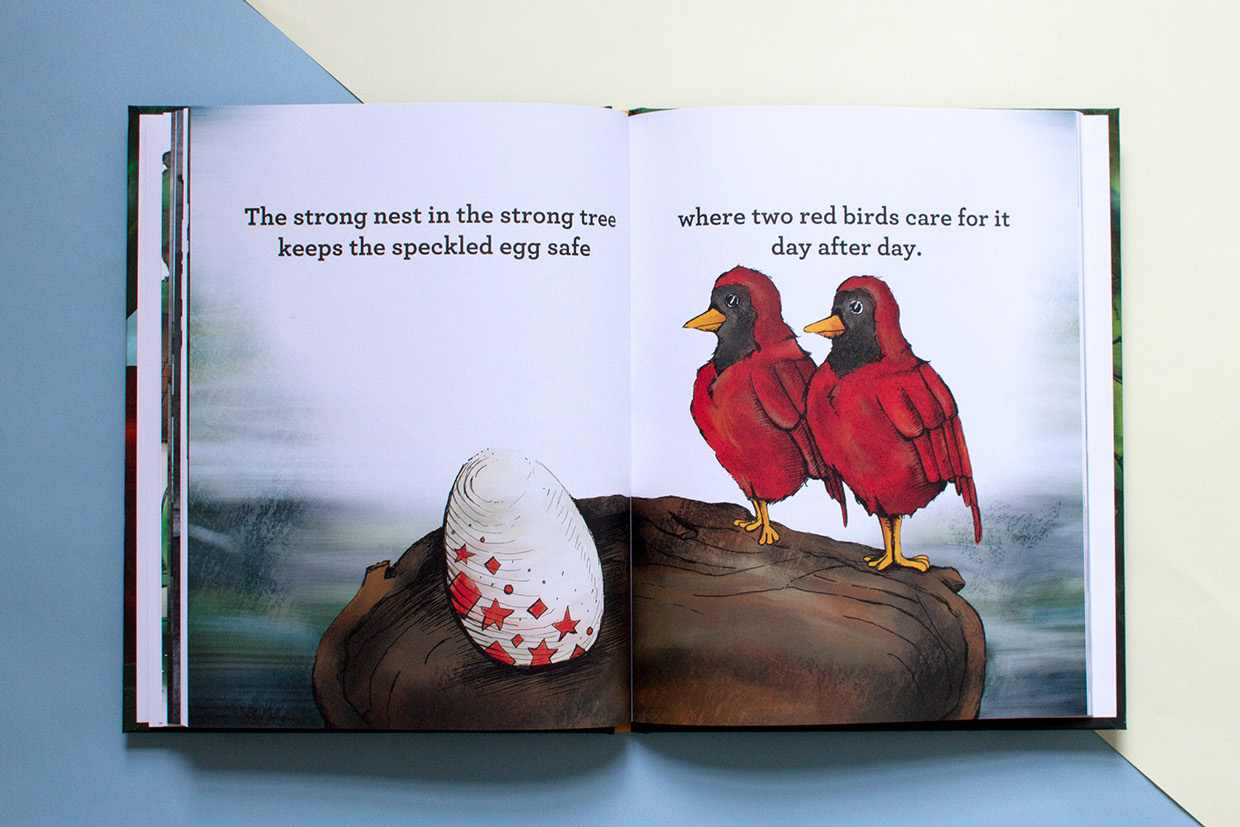 two red birds looking at the speckled egg in nest