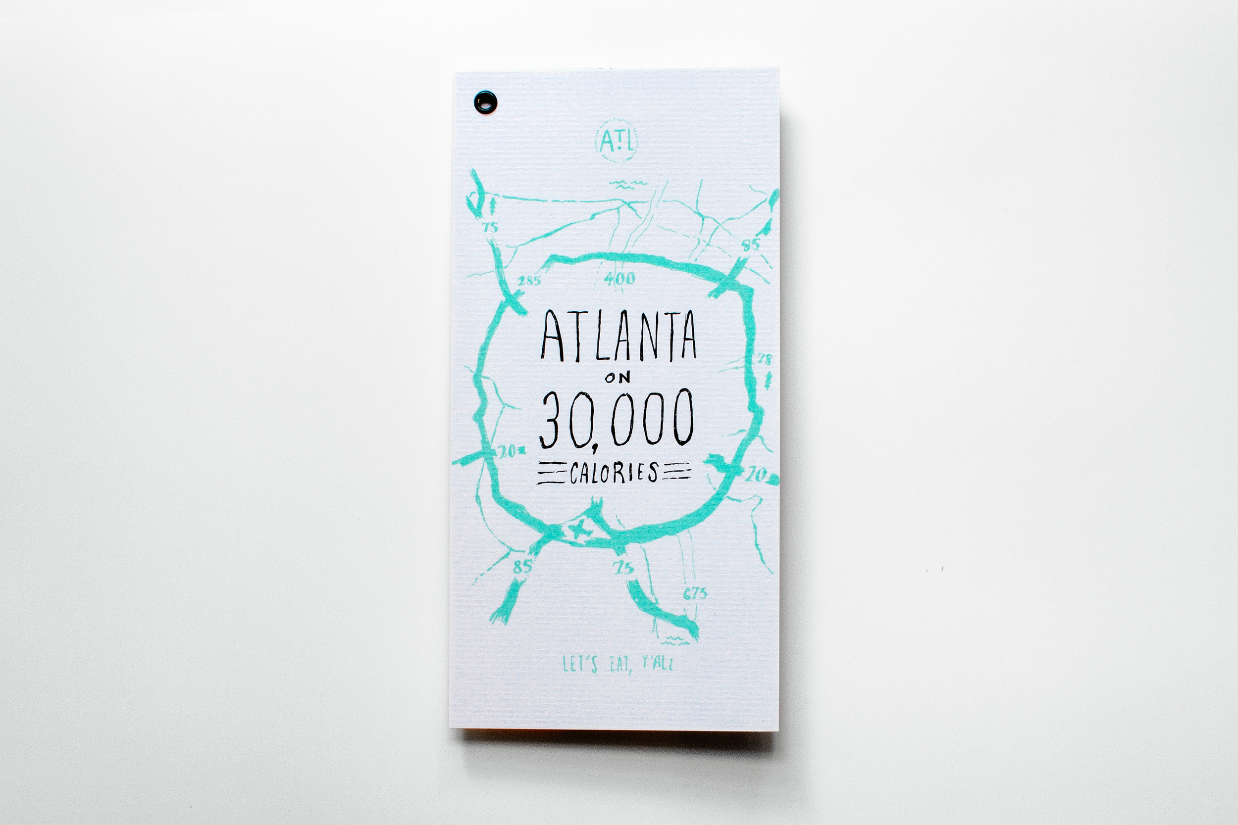 Atlanta on 30,000 calories illustrated map of food and restaurants in the city created by Russell Shaw for Neenah Paper Classic Future. The cover paper is CLASSIC Laid Cover Recycled 100 Bright White 80C.