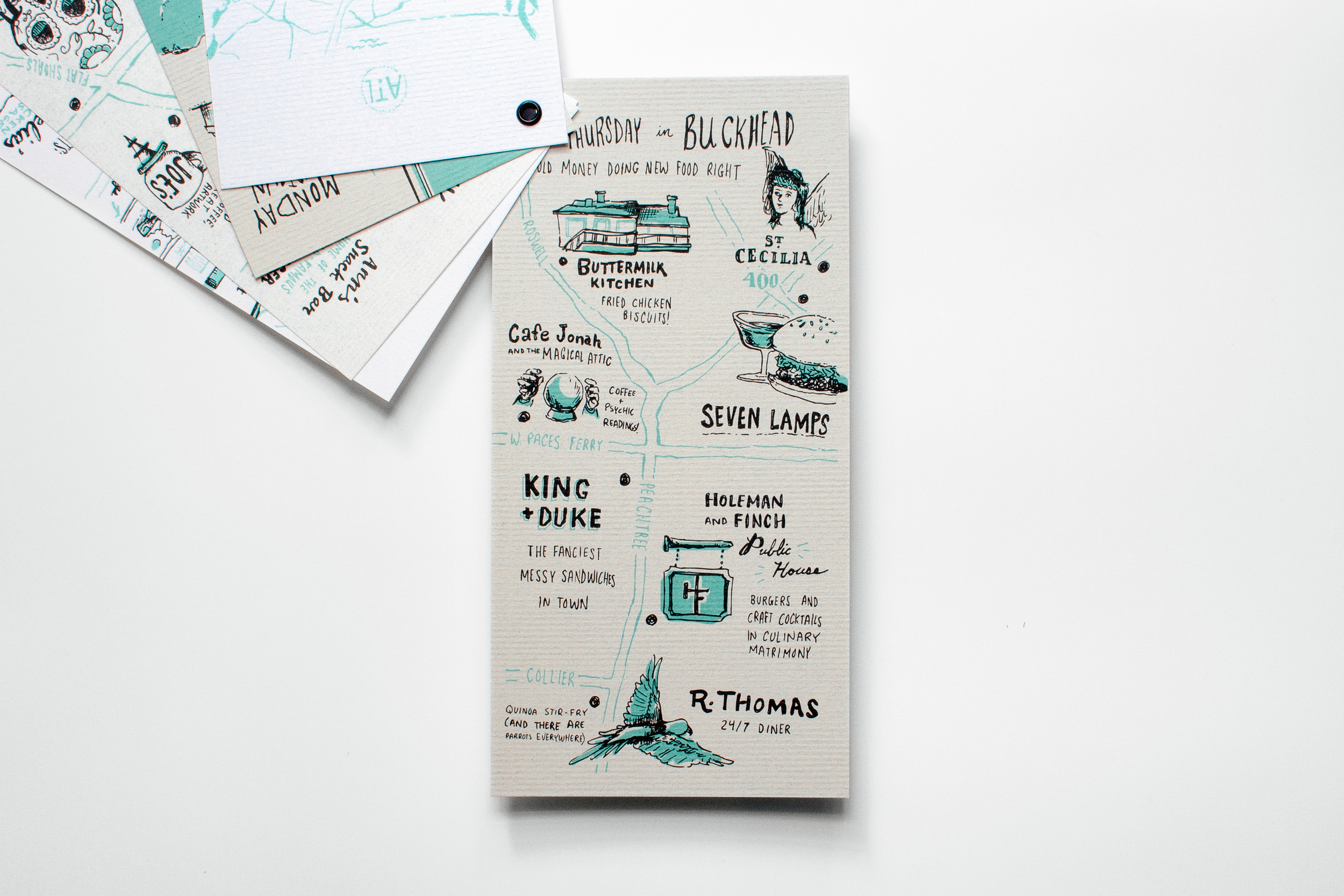 Hand drawn and hand lettering illustration work of a map of food and restaurants in Atlanta's buckhead neighborhood features the Buttermilk kitchen, st. cecilia, cafe jonah and the magical attic, seven lamps, king and duke, holeman and finch, and r. thomas. Printed on Neenah Paper CLASSIC Laid Cover Silverstone 80C.