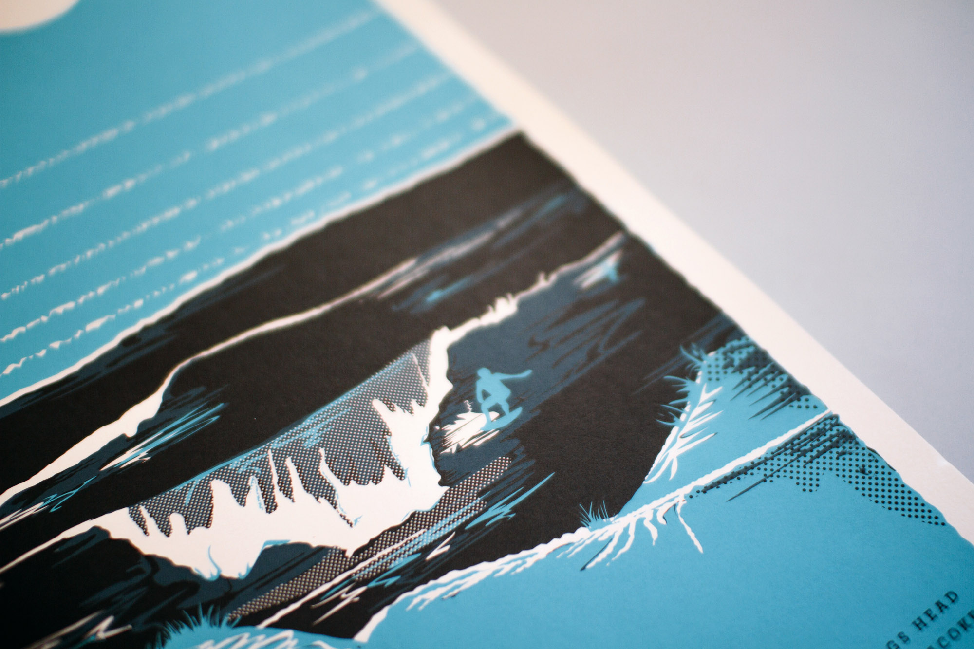 Graphic design and halftone illustrated poster screenprint of detail of surfer riding crashing waves on the blue color option of the outer banks print for bearings guide digital lifestyle publication.