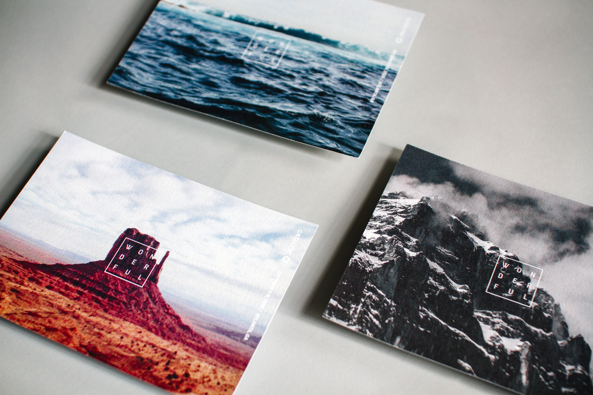"""Catalyst promotional postcards for Awaken the Wonder feature a """"Wonderful"""" typographic lockup in a square over beautiful photography of different landscapes deserts mountains and oceans."""