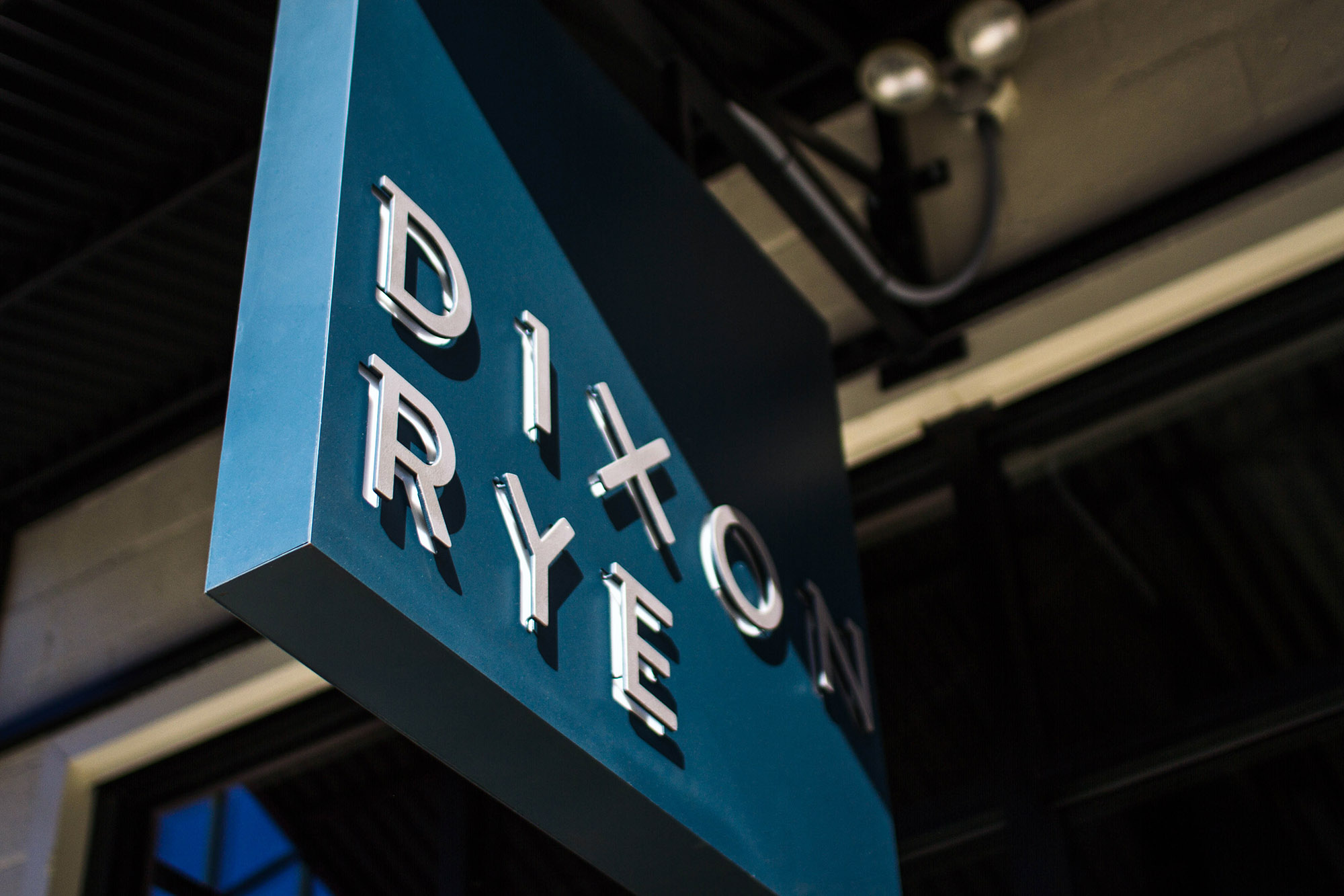 Up close detail of custom logo letters design for Dixon Rye on the Atlanta retail store's side entrance sign.