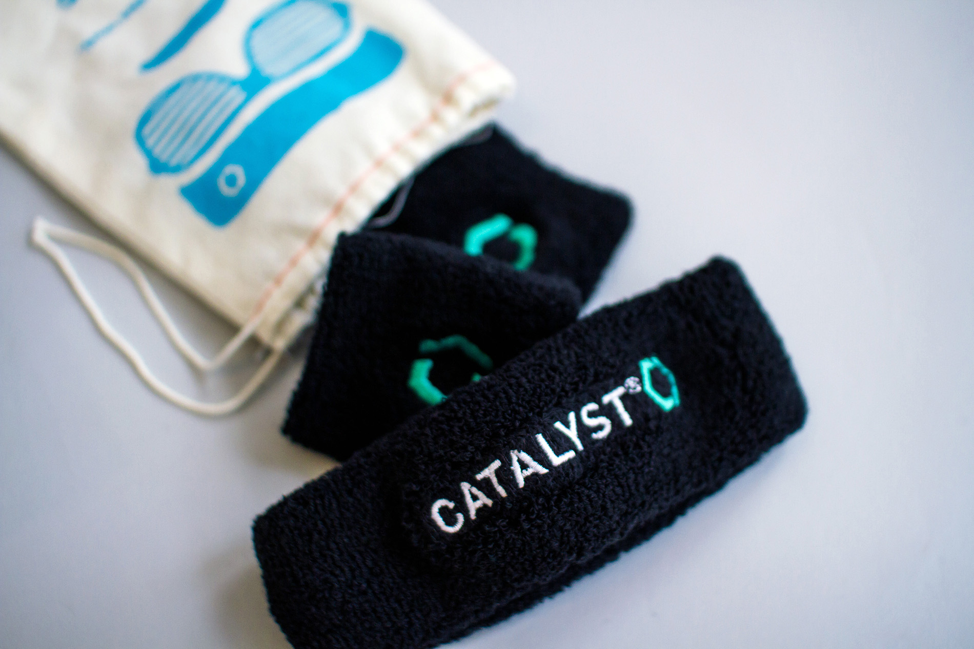 Custom headbands and wristband sweatbands with the Catalyst logo for the conference event theme promotion.