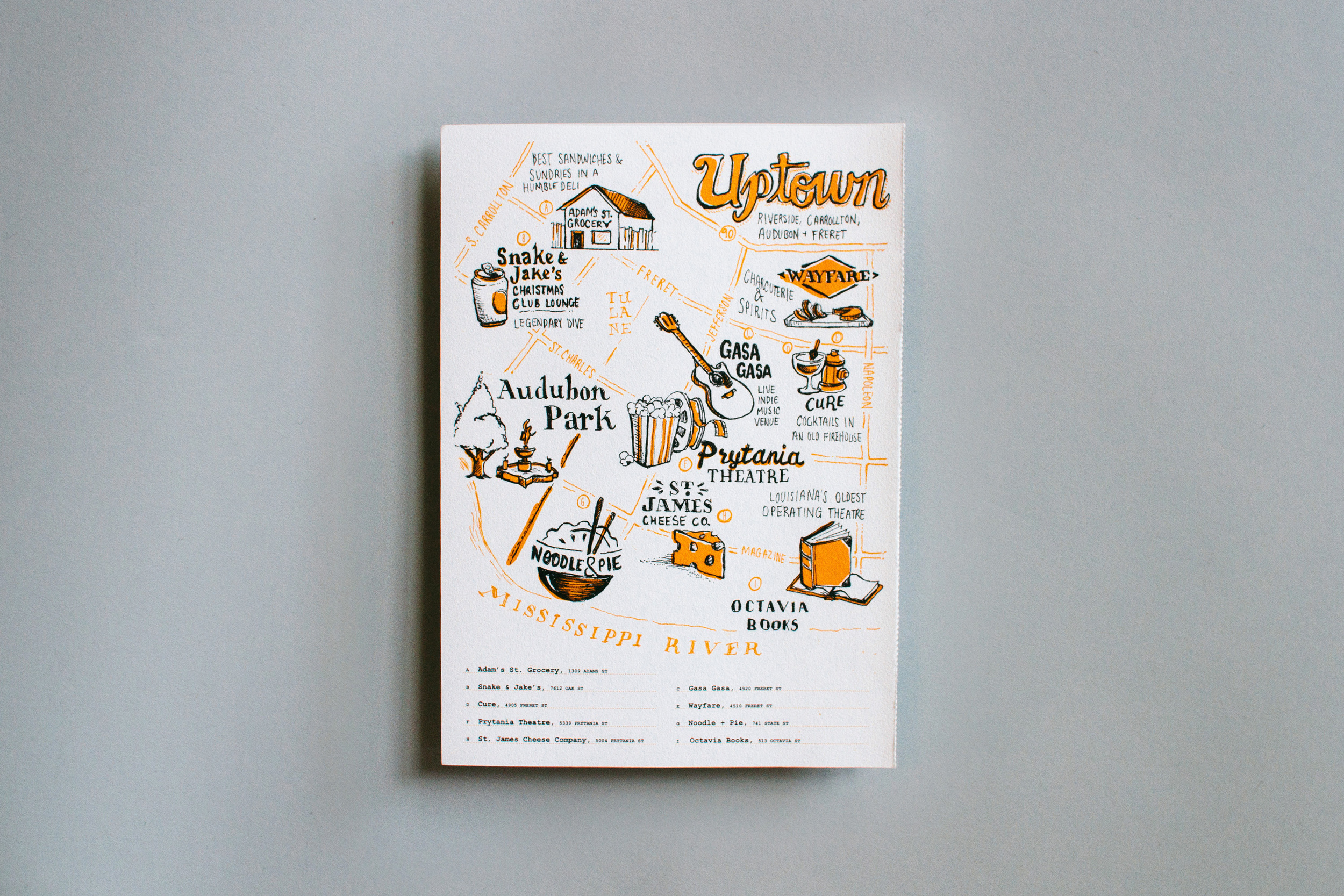 The hand illustrated and hand lettered two-color Uptown neighborhood map of New Orleans. Features Adam's St Grocery, Snake and Jake's Christmas Club Lounge, Wayfare, Gasa Gasa, Cure, Audobon Park, St. James Cheese Co, Noodle and Pie and Octavia books.