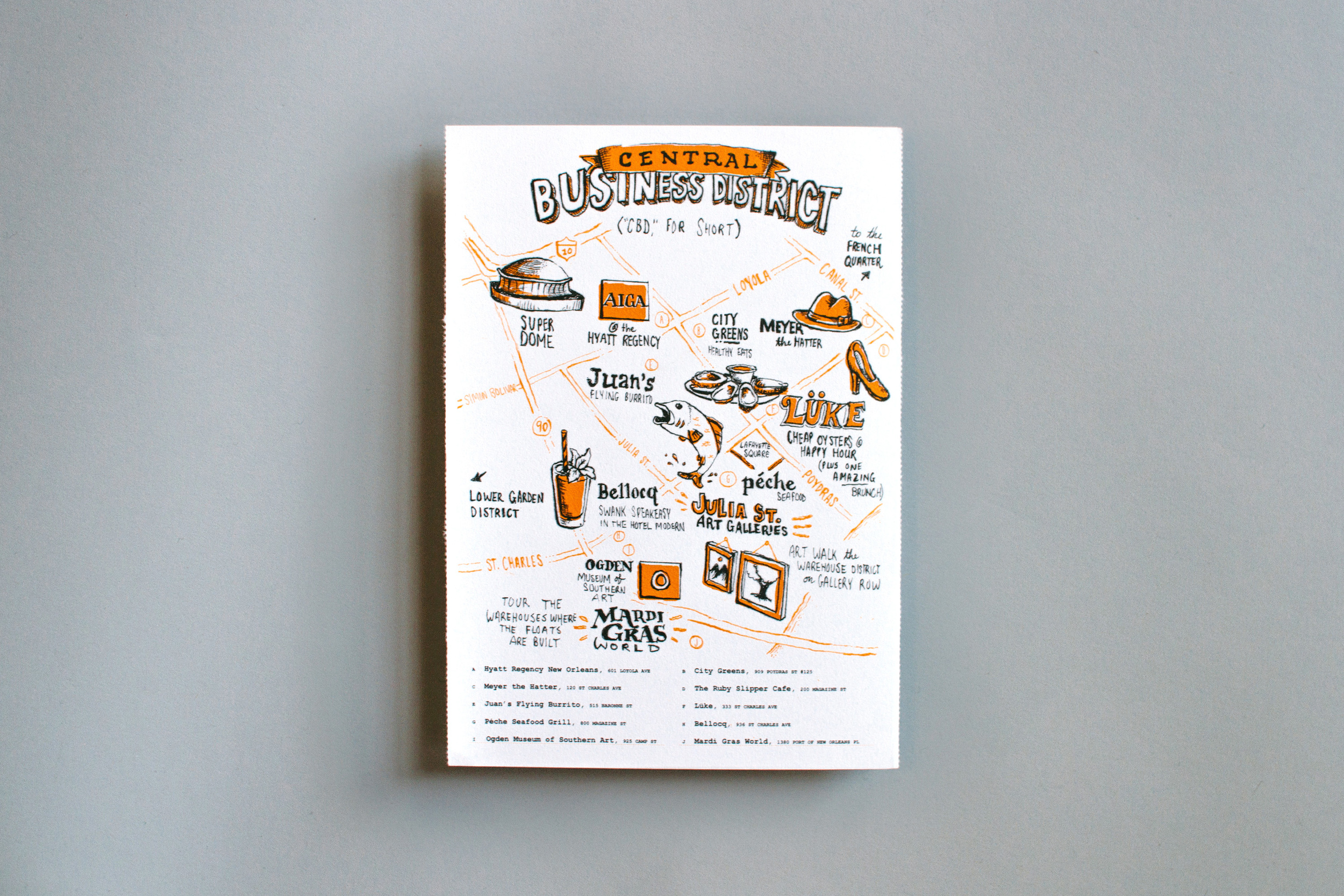 The Central Business District illustrated city guide, drawn and lettered for Neenah Paper's New Orleans promotional marketing materials at AIGA Conference. Features the Super Dome, Meyer the Hatter, Luke, Juan's, the Ruby Slipper, Bellocq, Julia Street Art Galleries, Peche, Mardi Gras World, and Ogden.