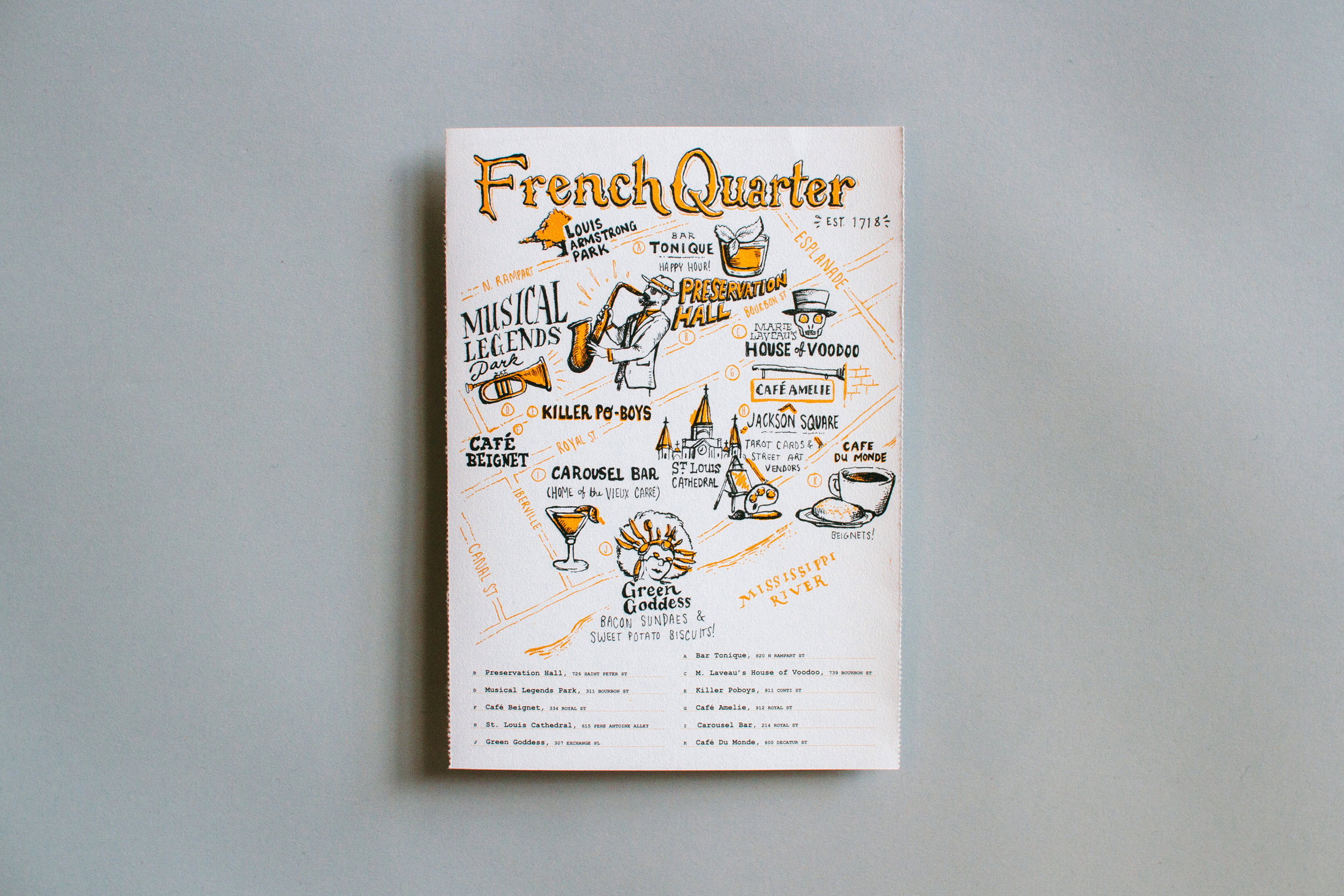Illustrated neighborhood map and hand lettering for the French Quarter of New Orleans. Features Louis Armstrong Park, Bar Tonique, Preservation Hall Jazz, the House of Voodoo, Cafe Amelie, Musical Legends Park, Killer Po-Boys, Carousel Bar, the Cathedral, Cafe du Monde beignets, and Green Goddess.