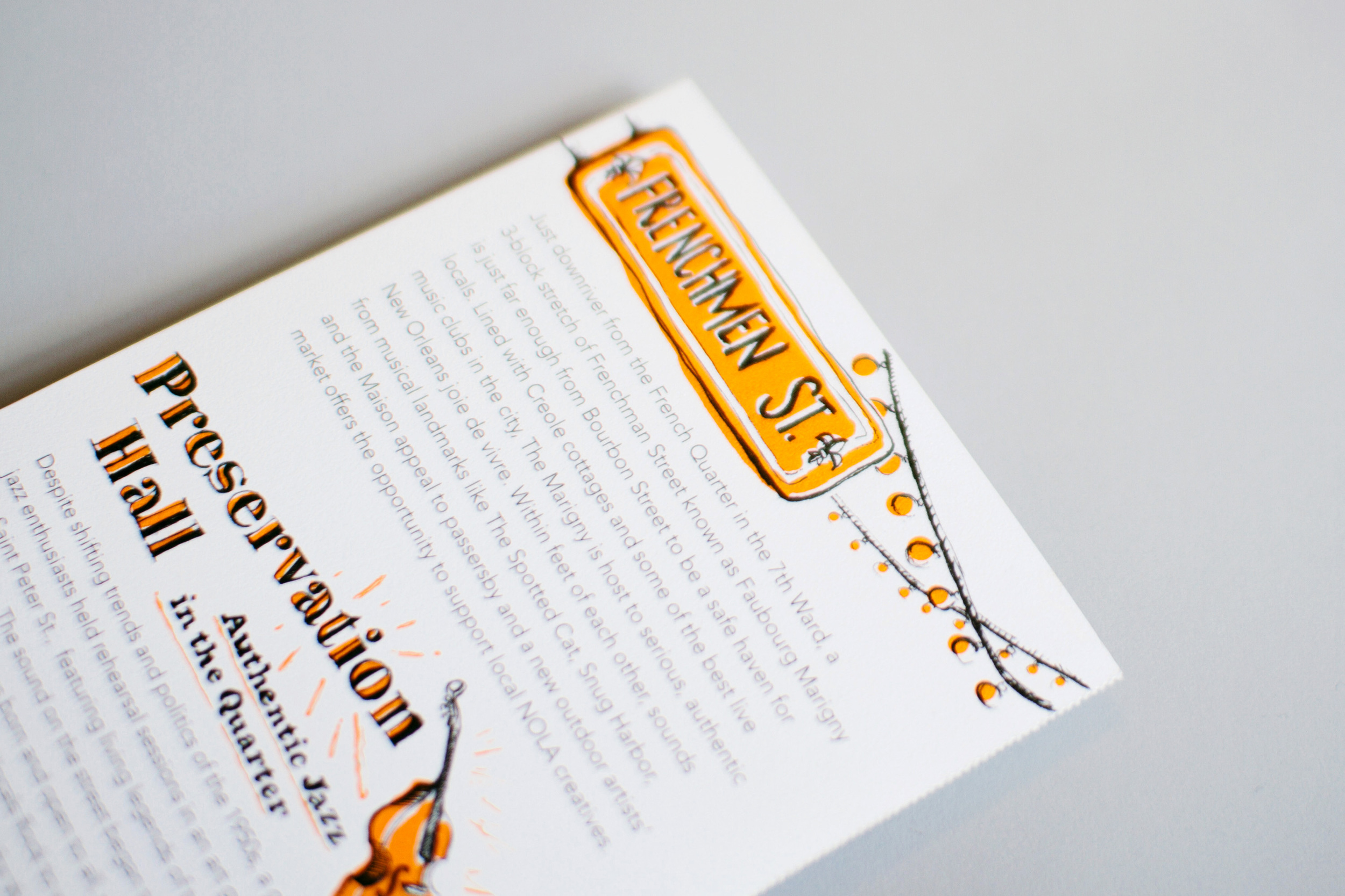 """Frenchmen Street hand lettering and biography and illustrated Preservation Hall title """"Authentic Jazz in the Quarter."""" The backs of each map also featured fun facts and historical and cultural information about New Orleans."""