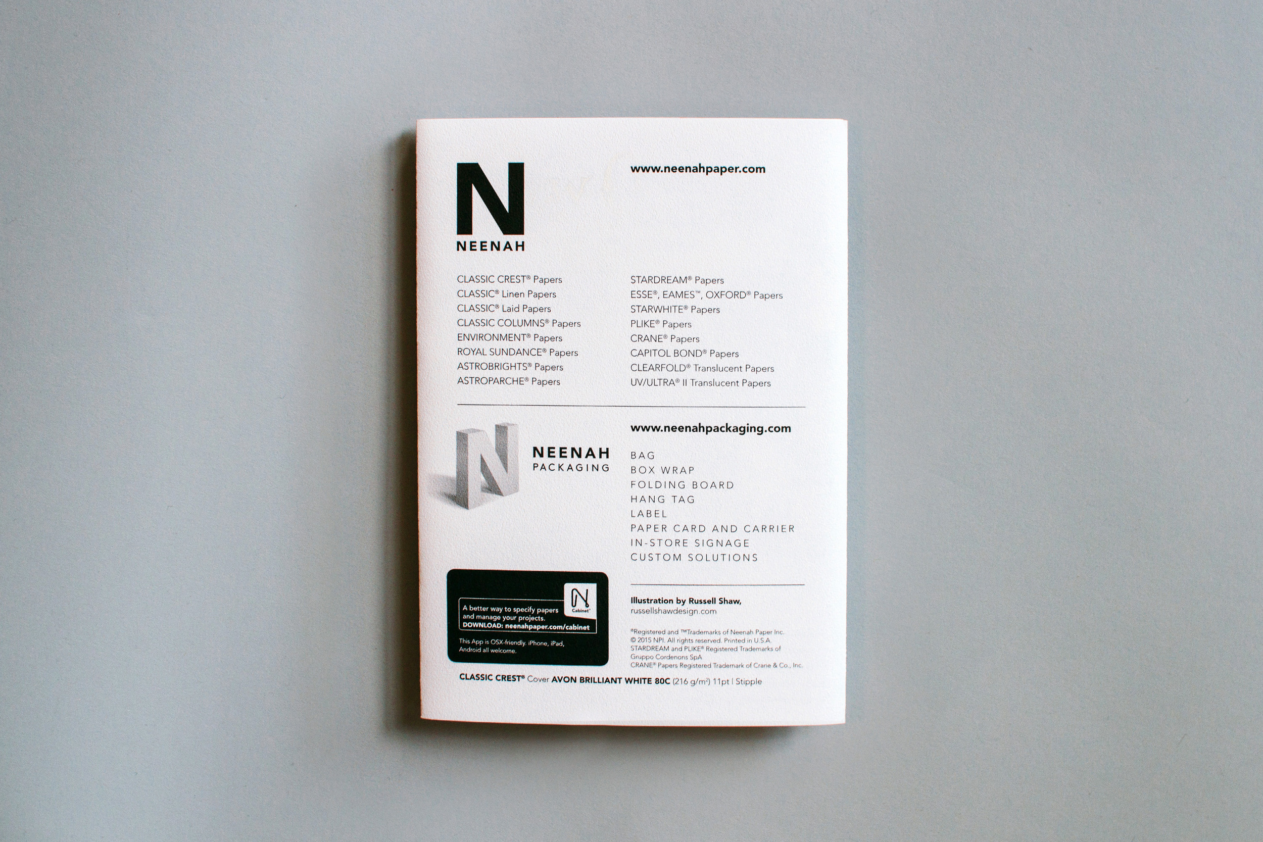 The back of the New Orleans with Neenah Paper promotional marketing design shows the line of Neenah products and Neenah Packaging options, with illustrated by Russell Shaw credit and paper information on Classic Crest Avon Brilliant White.