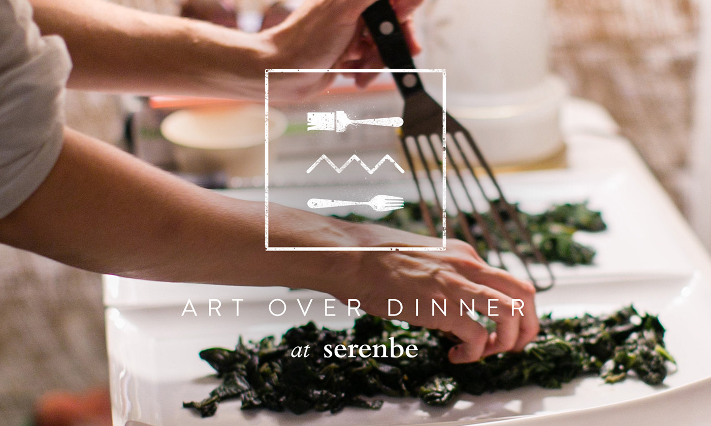 Hero graphic design for Art Over Dinner at Serenbe features the stamped textured logo design of paintbrush icon on top of fork icon branding in white over a photograph of a chef serving food.