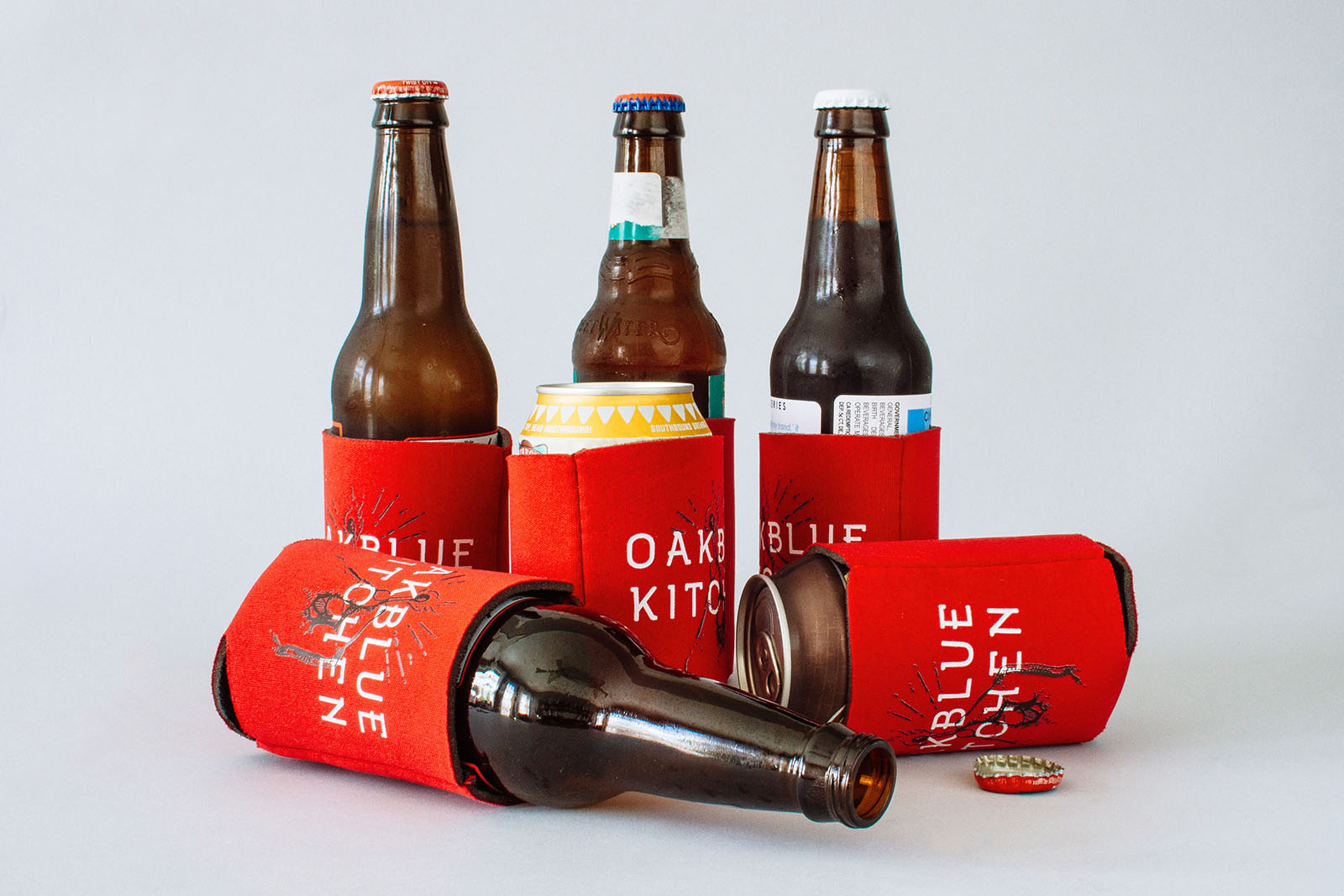 Red beer koozies with oakblue kitchen custom font and illustration.