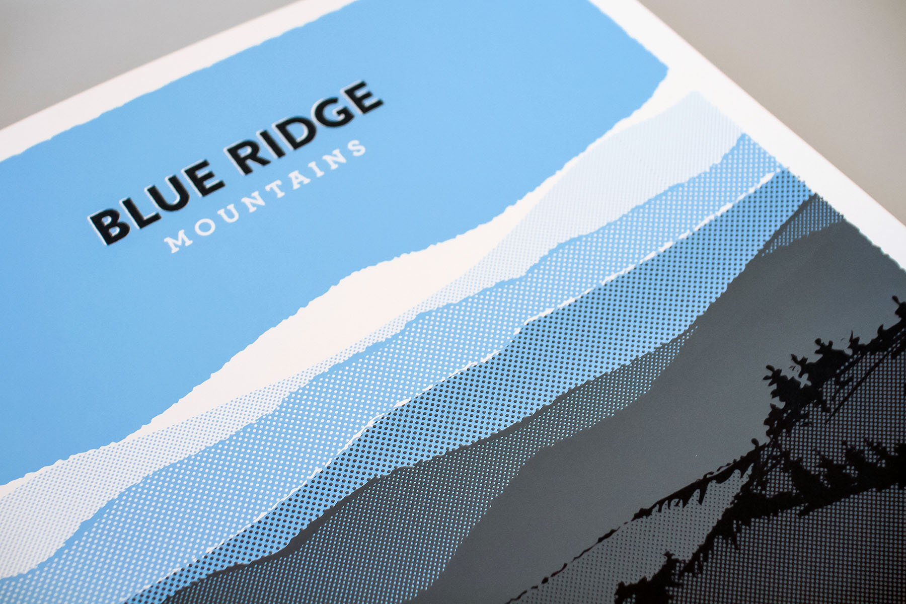 The blue ridge mountains poster is silk screen-printed in three spot pantone colors on a textured white paper.