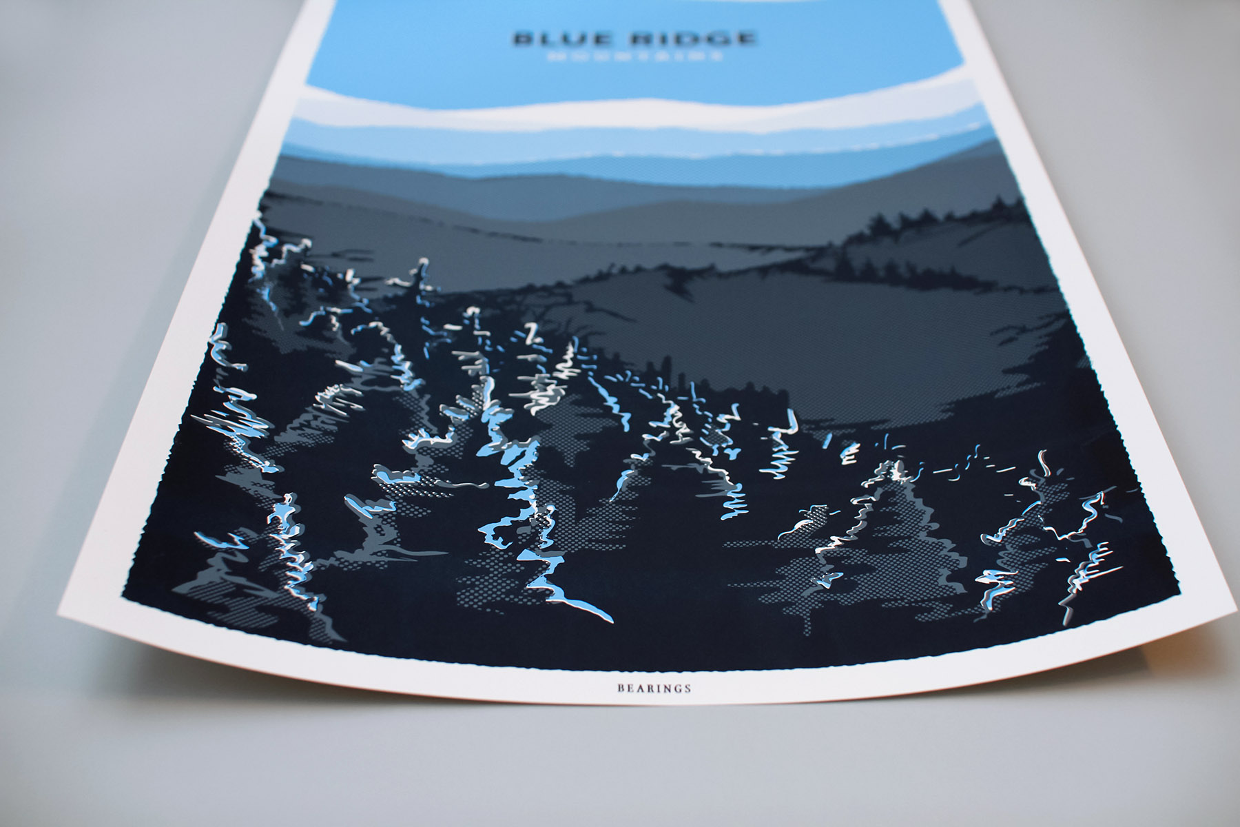 Graphic Designer Russell Shaw illustrated and designed this screen printed poster of the Blue Ridge Mountains for digital lifestyle publication Bearings Guide and it is sold in Citizen Supply in Atlanta Georgia.