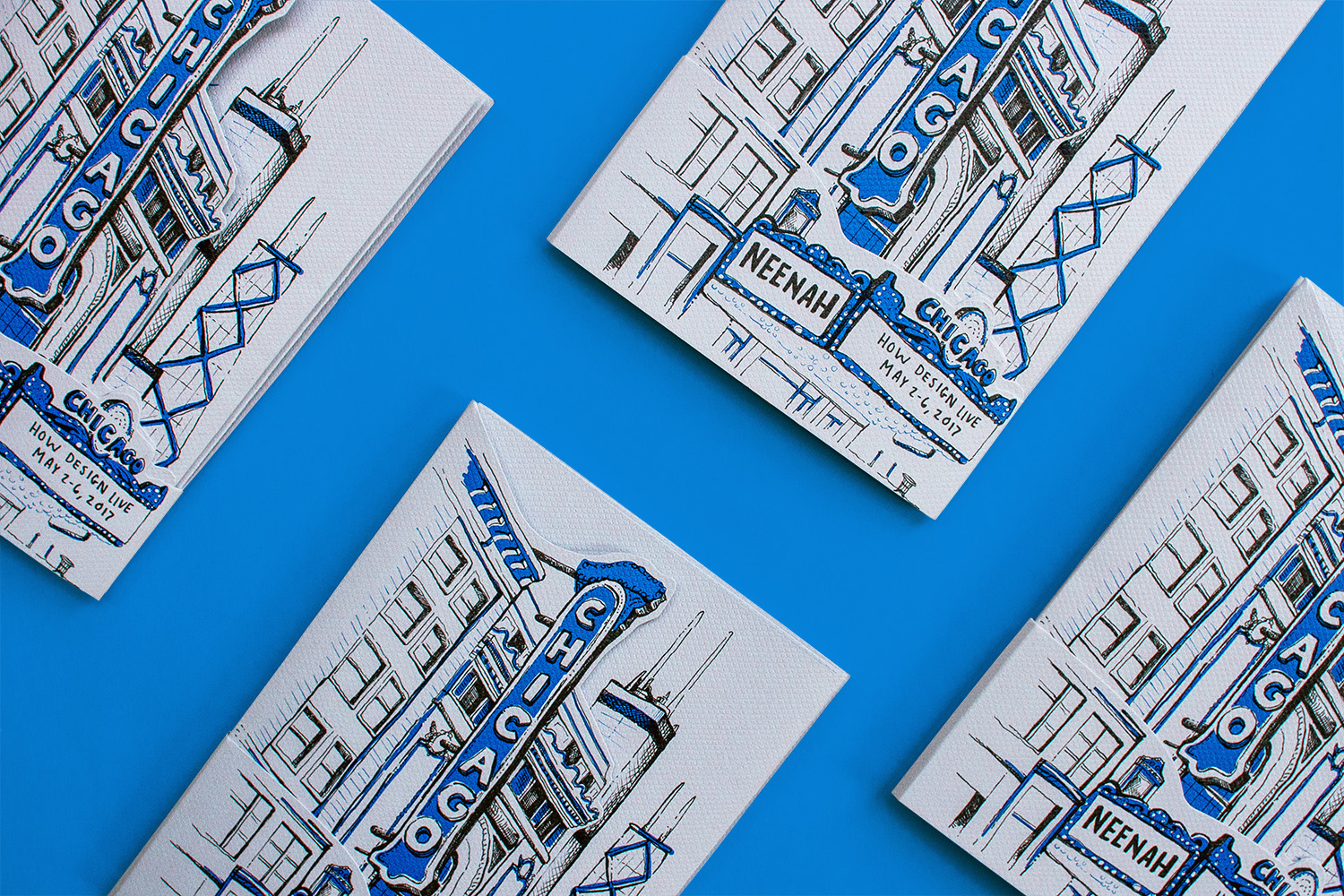 Cover design for Neenah Presents Chicago at HOW Design Live May 2-6 2017, featuring hand lettering and hand drawn illustrations of the Chicago Theater and the skyline.