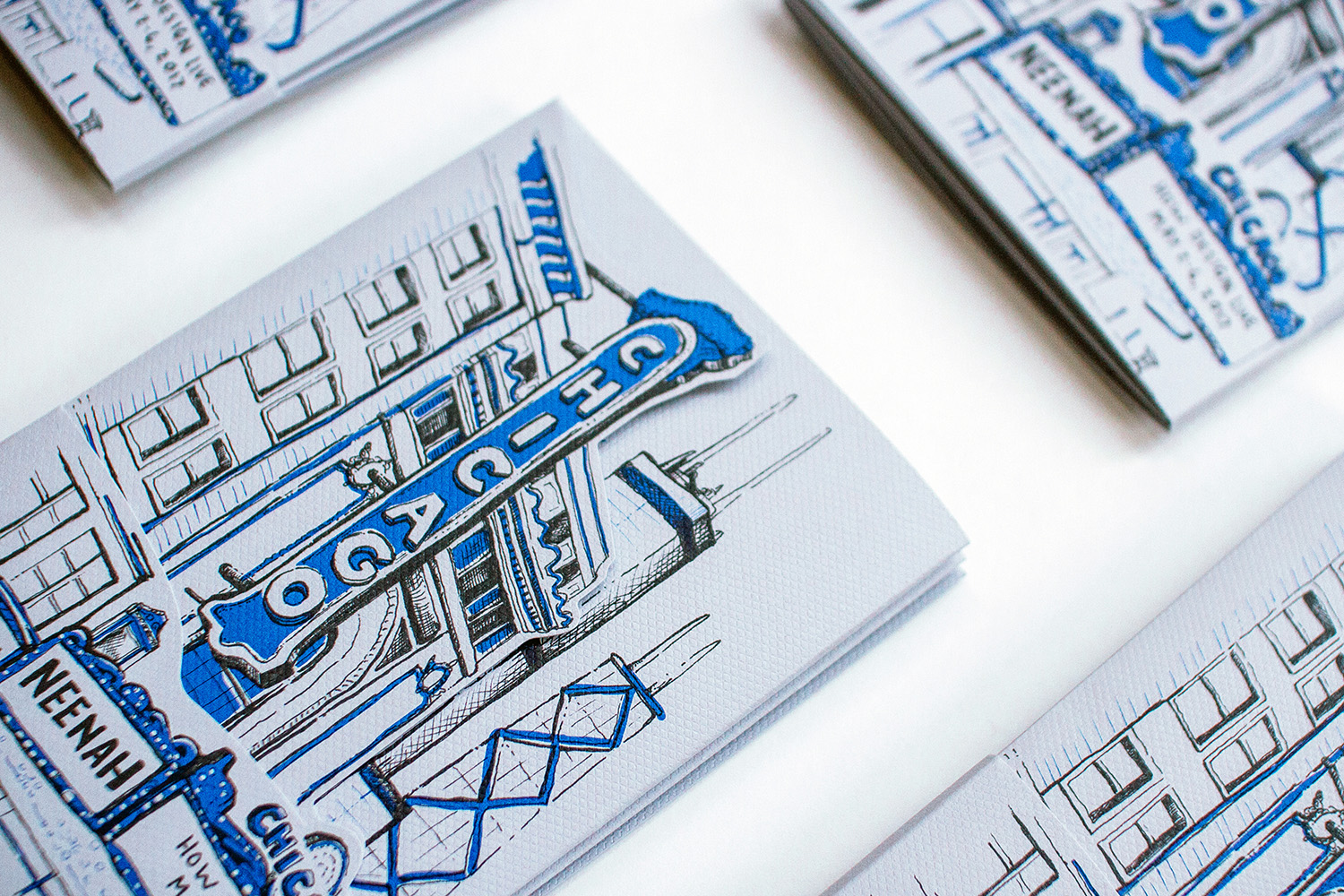 Graphic designer Russell Shaw created this multi panel custom diecut cover that shows an illustrated Chicago Theater on top with a hand drawn Chicago skyline behind it.