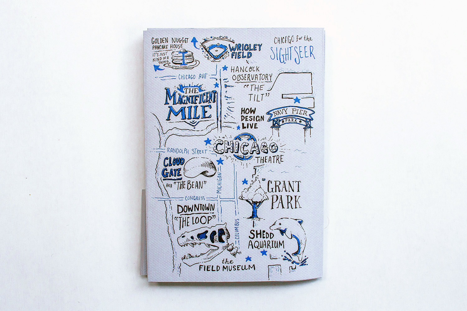 Hand drawn illustrated map of Chicago for the Sightseer at HOW Design live conference, showing Golden Nugget Pancake House, Wrigley field, hancock observatory, the magnificent mile, navy pier, grant park, chicago theater, cloud gate, downtown, the field museum, shedd aquarium.
