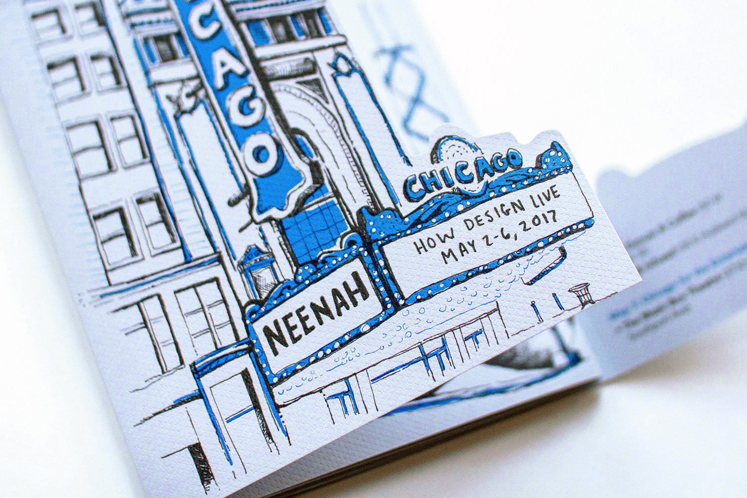The front flap of the diecut cover opens up around the edges of the Chicago theater marquee to reveal the skyline and maps underneath.