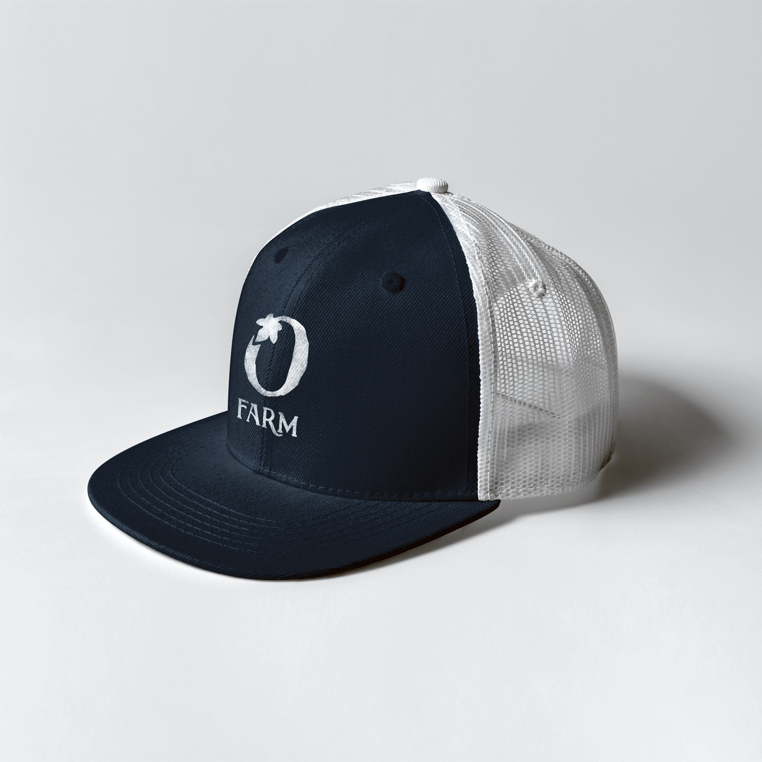 """O Farm"" icon logo and branding design for Olivette Farm on a navy and white trucker hat for the branding collateral and apparel."