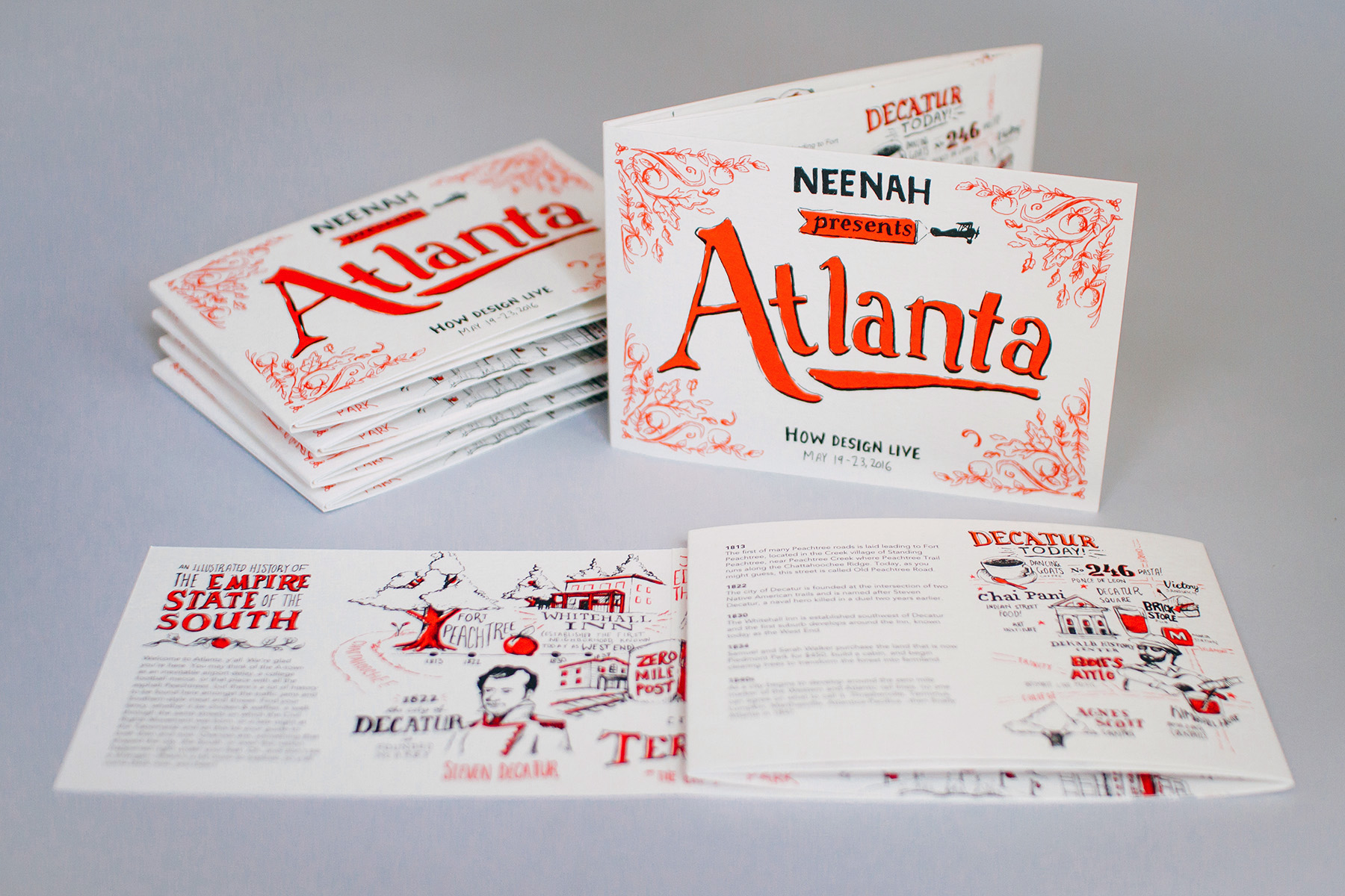 """A stack of the """"Neenah presents Atlanta,"""" for How Design Live 2016, illustrated timeline and map. Reveals the hand drawn color illustration and the open first panel to the Decatur today neighborhood city map."""