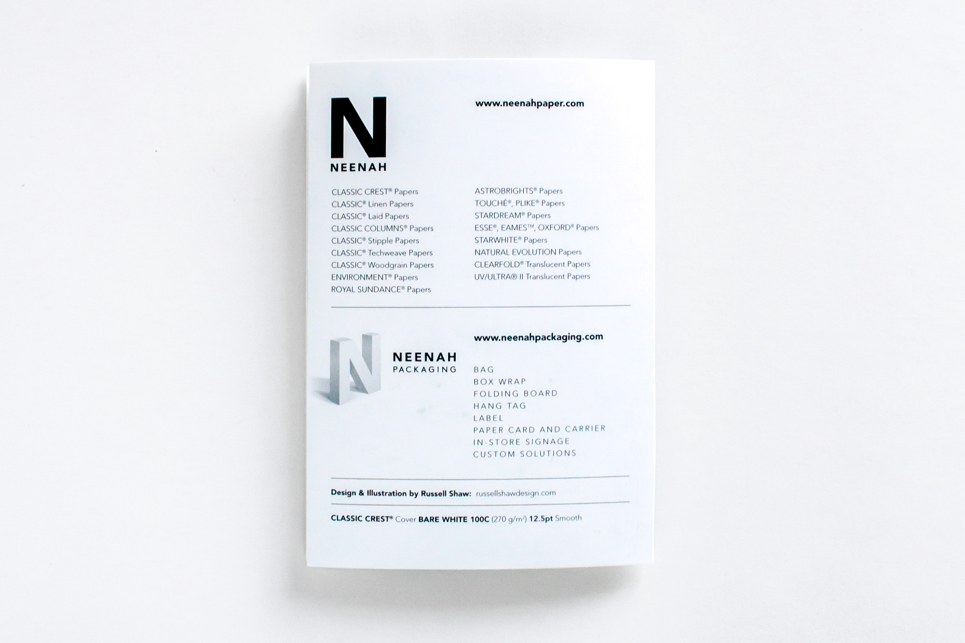 Back cover design of the Neenah Paper Presents Boston HOW Design Live 2018 conference promotional materials shows the full Neenah and Neenah Packaging product listing and credits Design and Illustration by Russell Shaw, with the paper Spec Classic Crest Cover Bare White 100C 12.5pt Smooth.