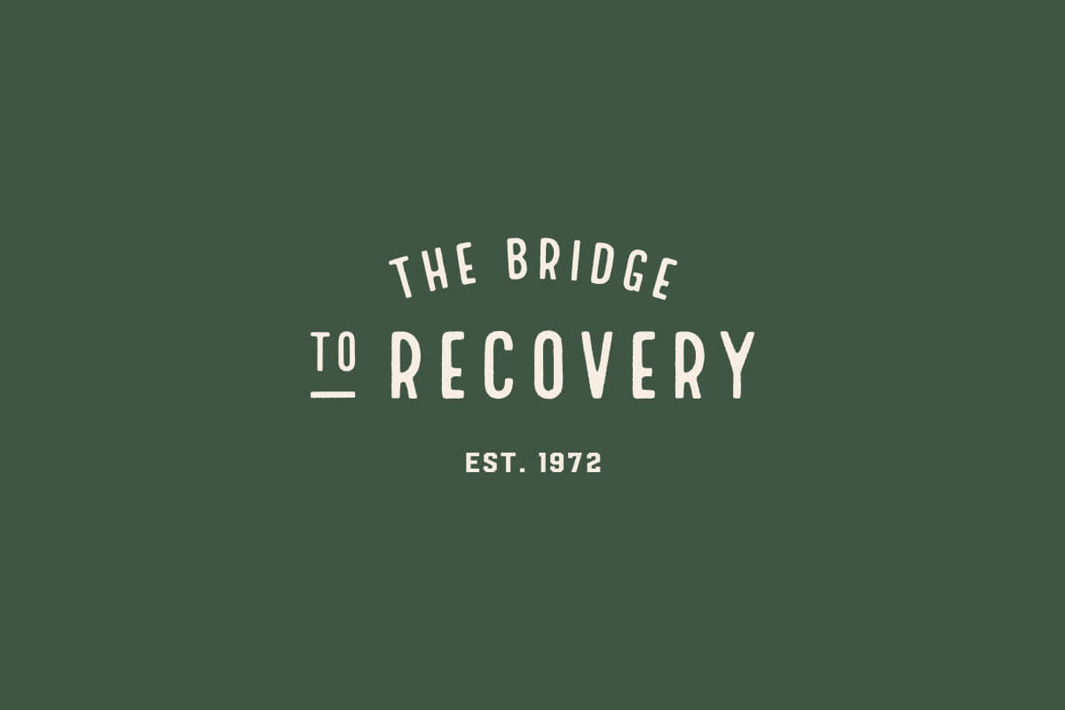 The Bridge to Recovery logo design has arc letters that make a bridge over the word Recovery