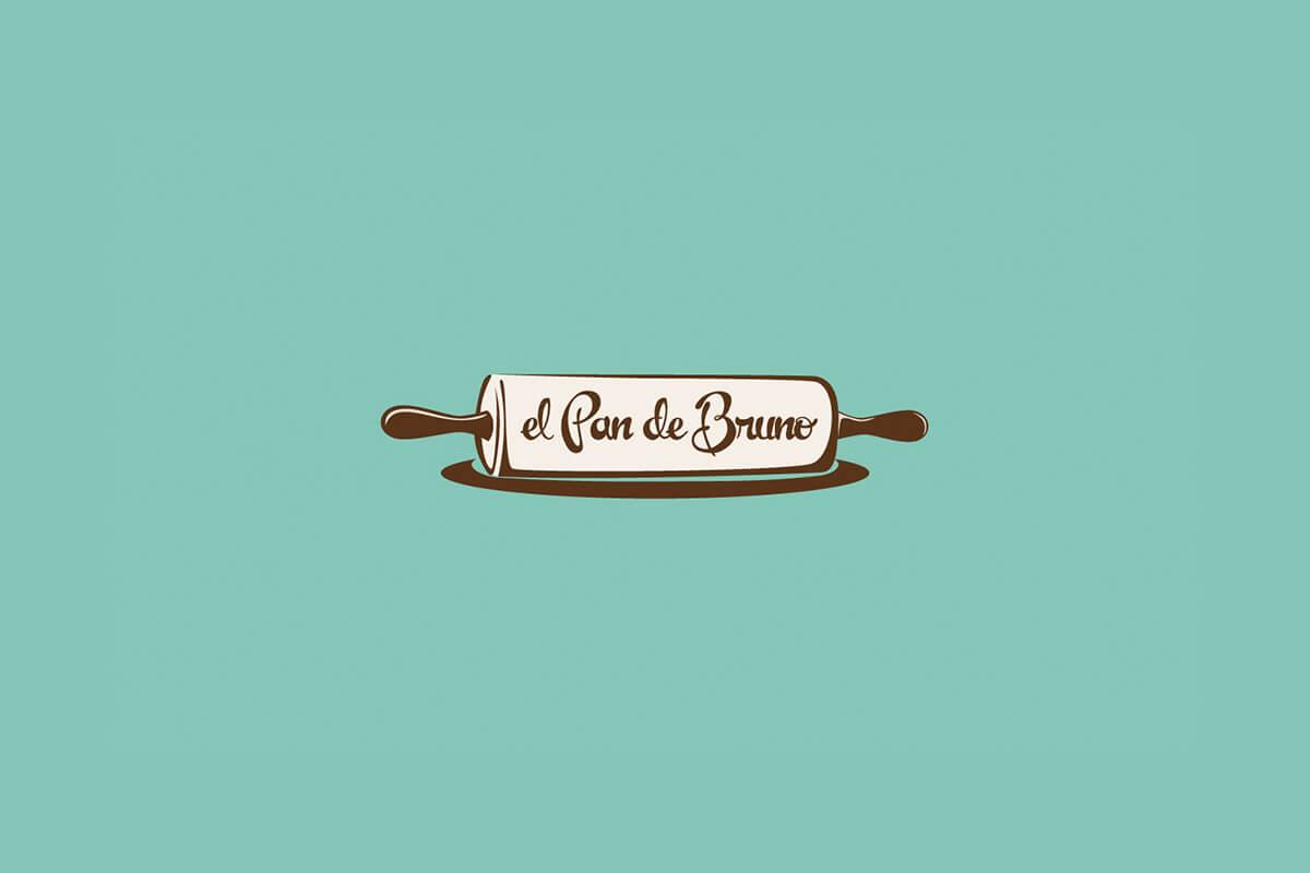 El Pan de Bruno logo design with script letters written across a rolling pin