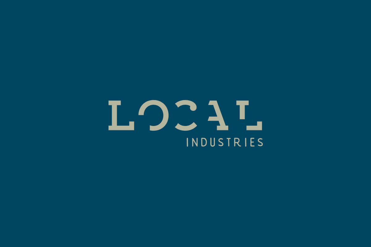 Local Industries logo design with partial broken slab serif letters