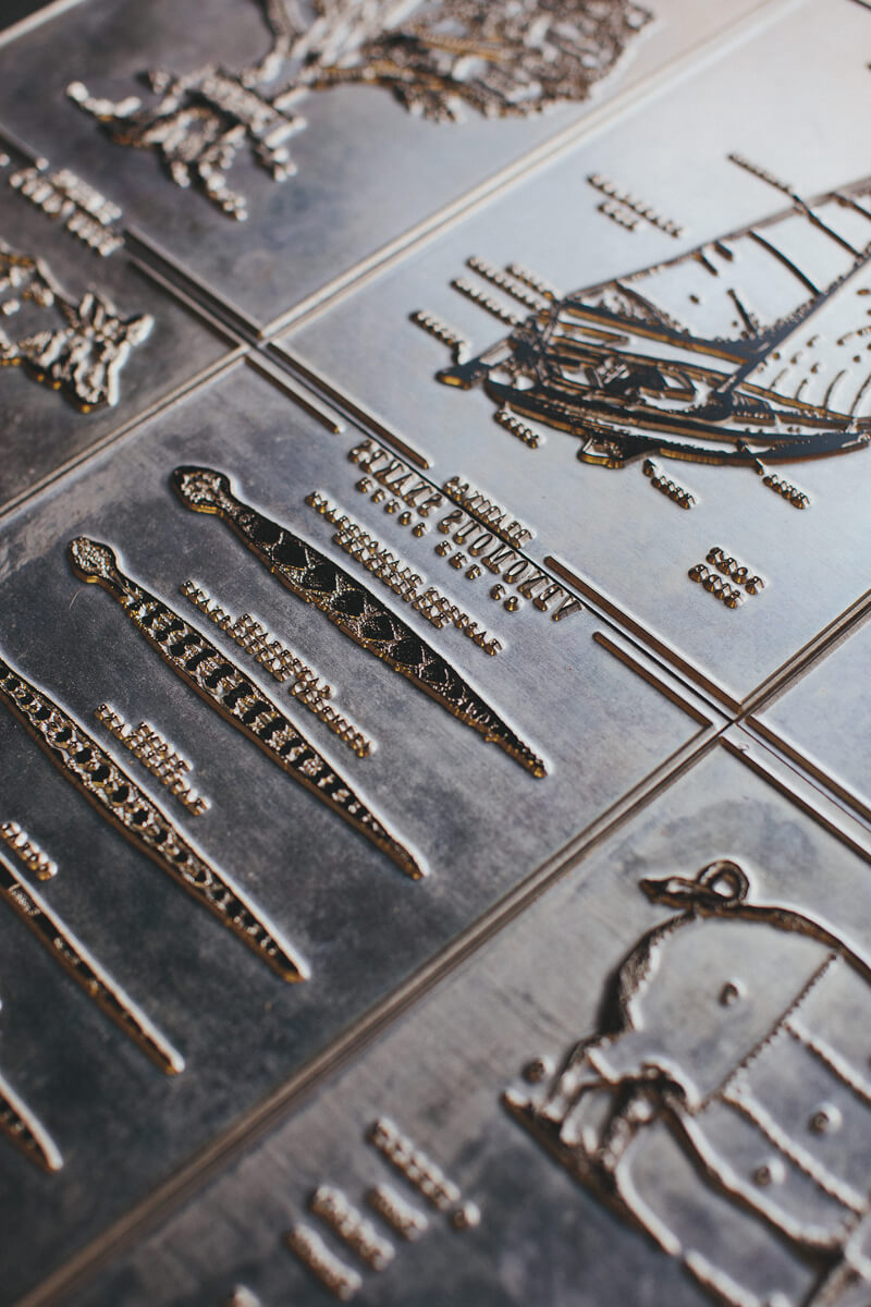 The original letterpress plates made out of metal stacked side by side for the Bearings letterpress infographic series with the focus on the types of snakes of the south print.