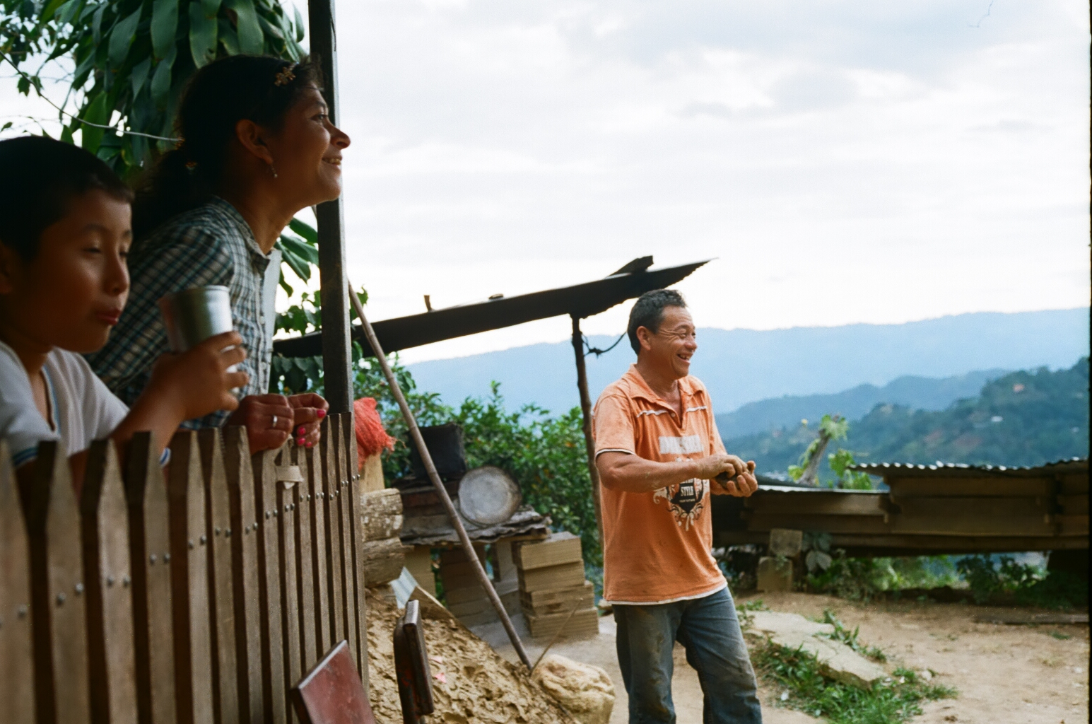 Playing TEJO, a Colombian traditional sport, and favorite pastime among farmers and their families.