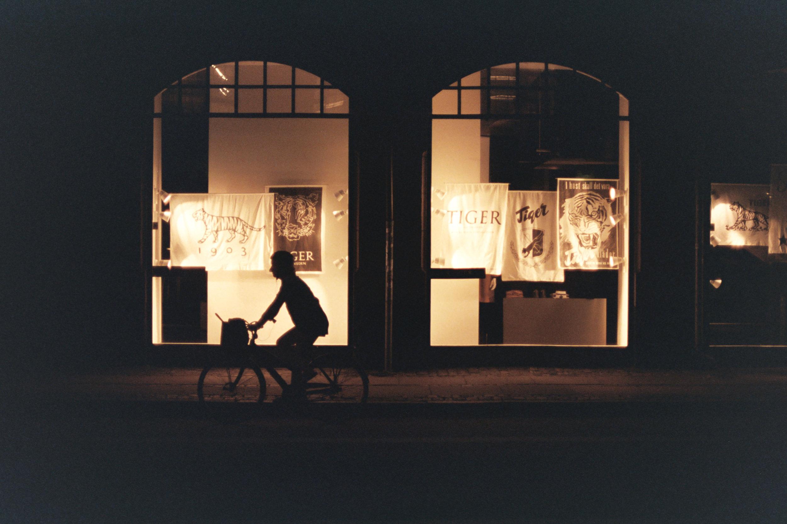 Copenhagen, Denmark. Twilight. Silhouette from shopfront.