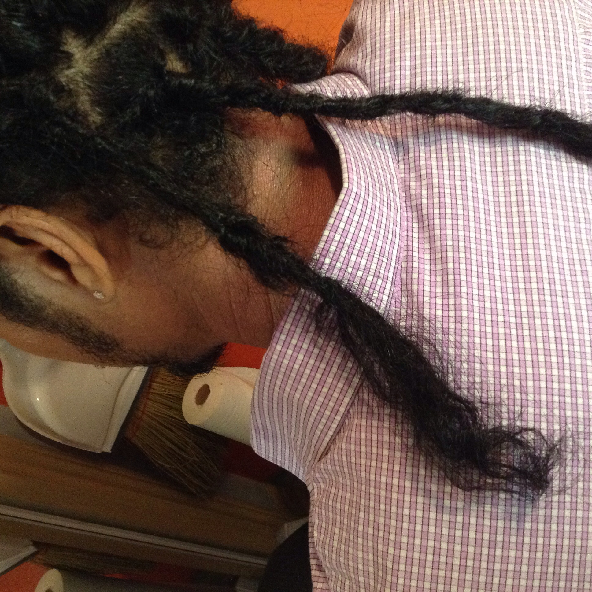 Loc with loops toward the root & loose hairs at the end