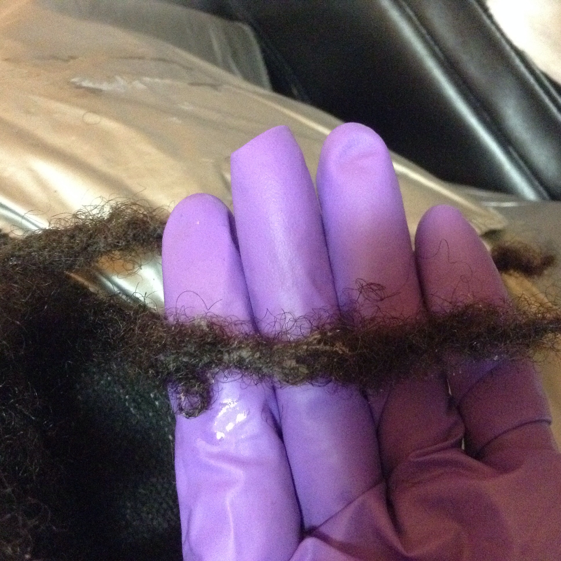 Over tightening causes hair to coil extremely tight and is a prime location for lint to get trapped.  ©2015