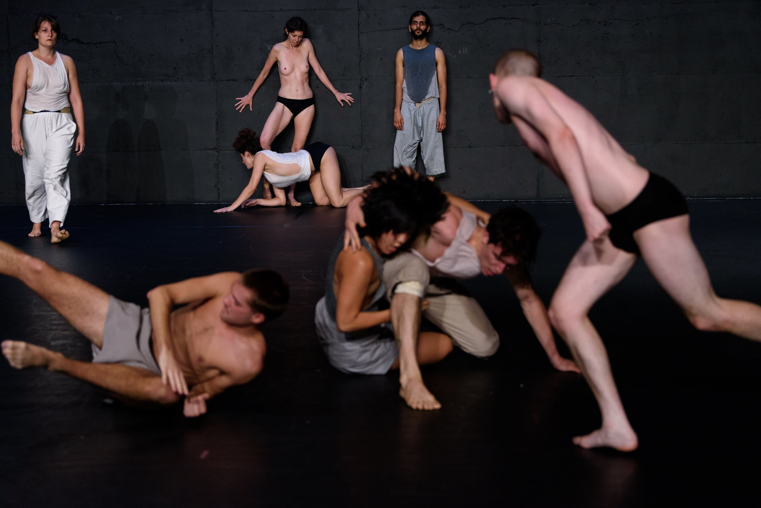 """""""Y"""" -    2018, New York Live Arts; Conceived & Directed by RoseAnne Spradlin; Movement Scores created in collaboration w/ the Dancers; Sound by Glen Fogel & Ben Manley; Lighting by Roderick Murray; Front L-R: Doug LeCours, Annie Heath, Thomas Welsh-Huggins, Connor Voss - back L-R: EmmaGrace Skove-Epes, Claire Westby, Athena Malloy & Ainesh Madan. Photo: Ryutaro Mishima"""