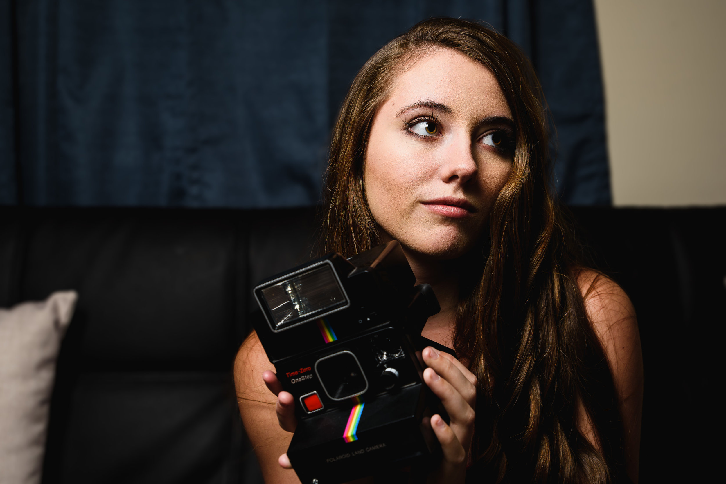 Nikon D750 Tamron 24-70 f/2.8 G2 @ 45mm 1/125s f/5.6 ISO 100 - Portrait of a photographer with a Polaroid one-step instant camera.