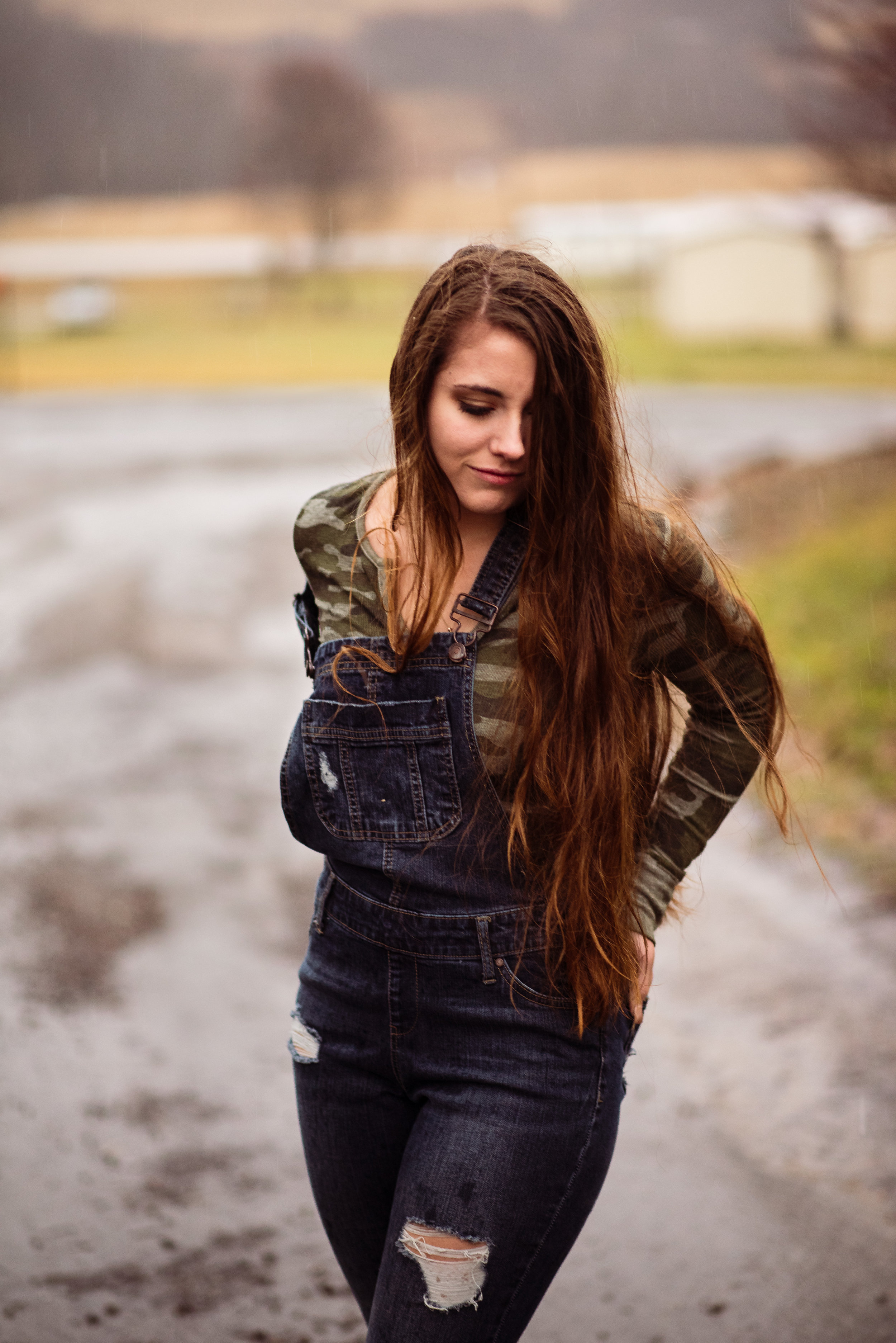Long-haired girl in the rain.