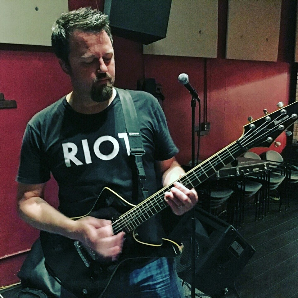 Hugh with one of his custom made guitars