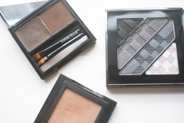 Brow products: powders. Clockwise from top left: Benefit Brow Zings in Dark, Burberry Complete Eye Palette in 01. Smokey Grey, Bobbi Brown Eye Shadow in Taupe.