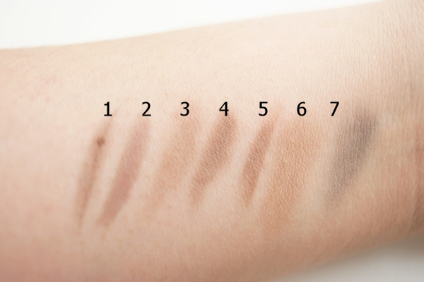 Swatches, left to right: 1, Clinique Superfine (04 Black/Brown); 2, Soap & Glory Archery brow tint; 3, Soap & Glory Archery brow pencil; 4, Benefit Brow Zings (Dark, wax); 5, Benefit Brow Zings (Dark, powder); 6, Bobbi Brown Taupe; 7, Burberry 01 Smokey Grey palette (matte grey).