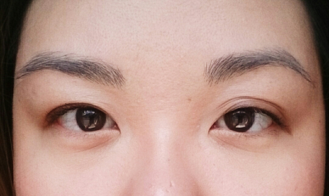 I have uneven EVERYTHING. (Pictured: product-less brows.)