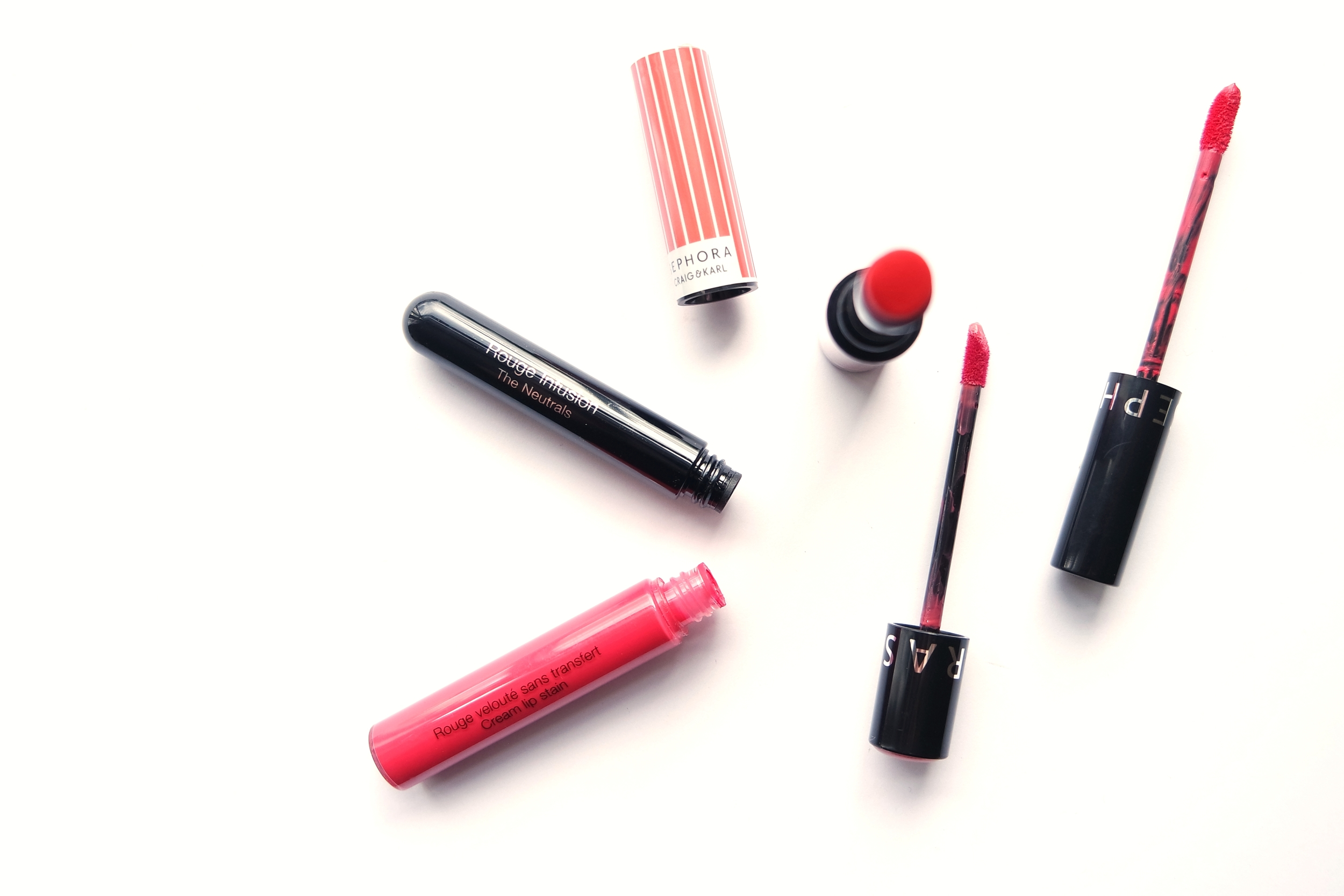 Sephora own brand lip products:Cream Lip Stain in 03 Strawberry Kissed, Rouge Infusion in 19 Peony, and Craig & Karl Lip Color Last in West End Swirl.