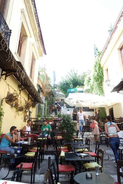 Cafes, bars, and restaurants all spilling out into the Plaka terraces.