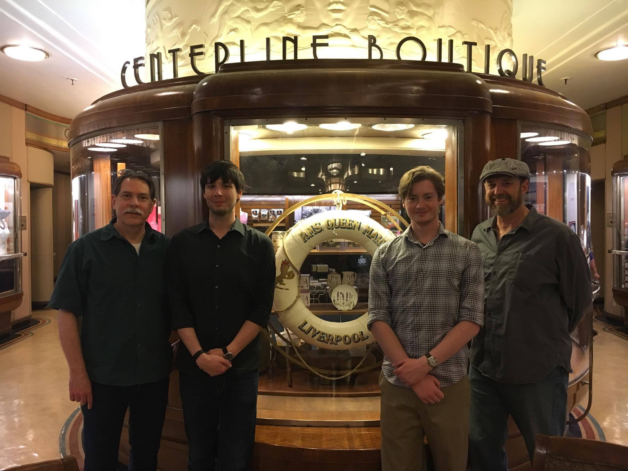 From left to right: Ken Marschall, Matt DeWinkeleer, Thomas Lynskey, and Parks Stephenson aboard Queen Mary docked in Long Beach, California.