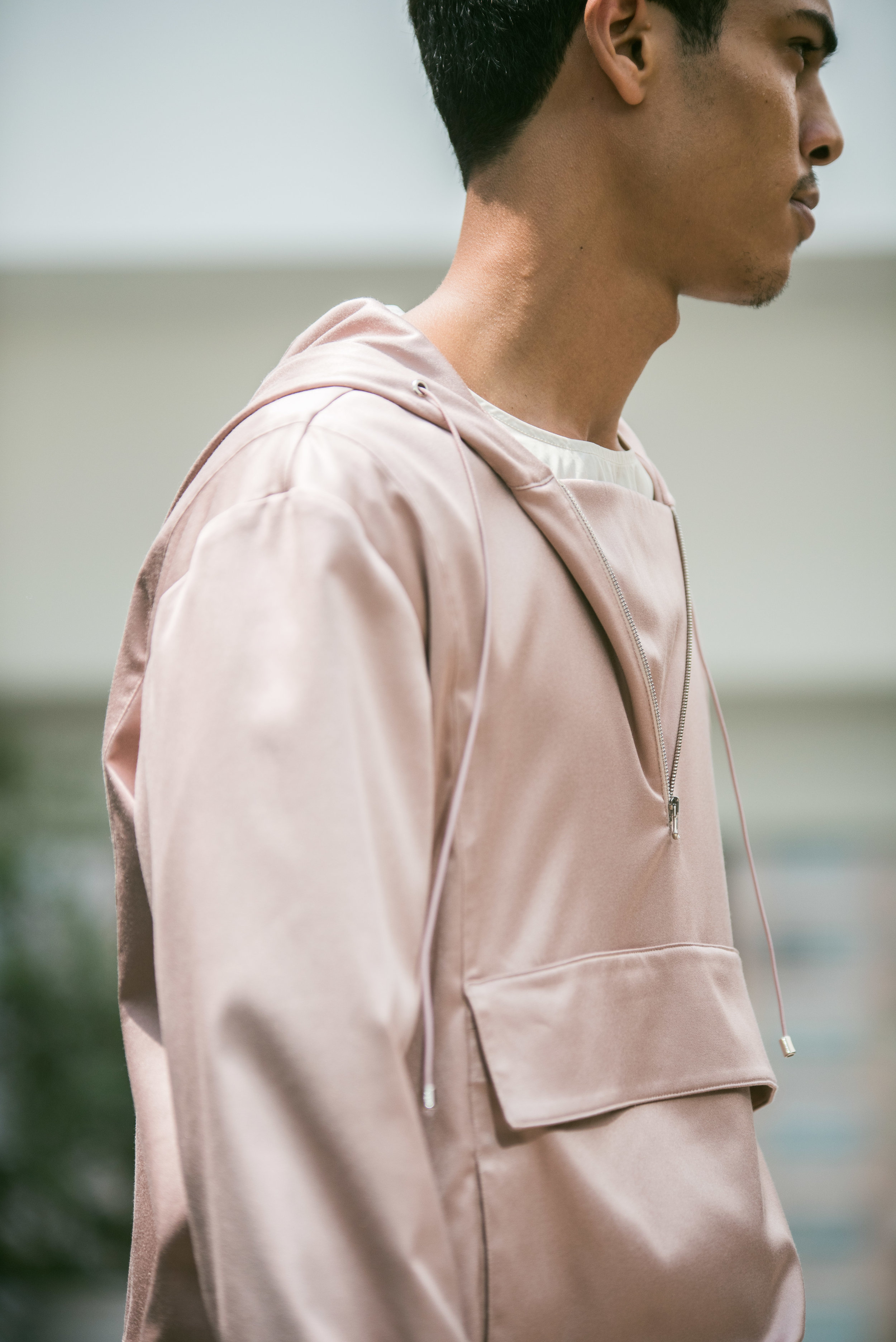 COMPLEX Spoke to stylist Taylor Okata about the Pink Outerwear trend for Spring 2017 and why he chose a rosé colored, long, silk Anorak to open the Deveaux Spring 2017 runway show -