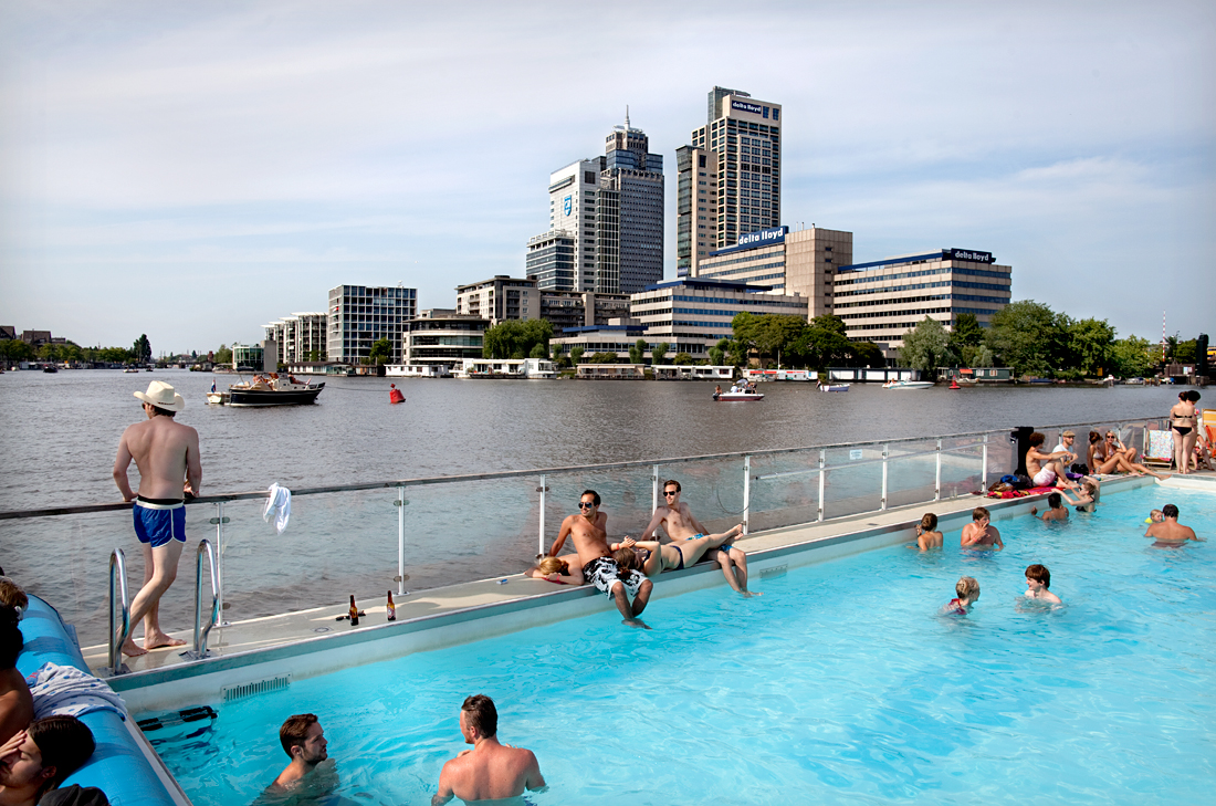 Amsterdam, the Netherlands.  A flooting swimming pool in the Amstel river.