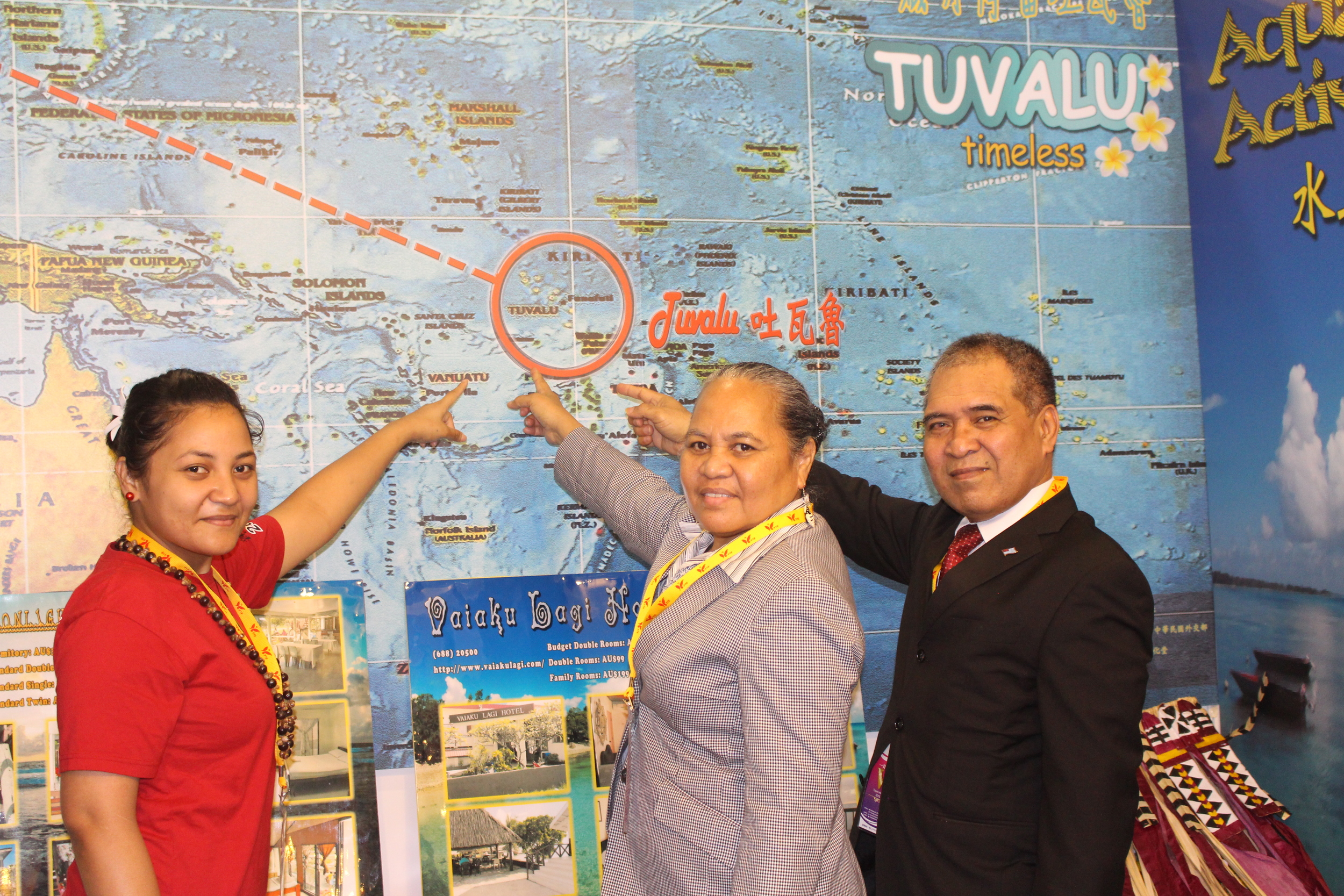 Ambassador and Madame Taupo with Tuvaluan student Sose Sio in the Tuvalu Booth