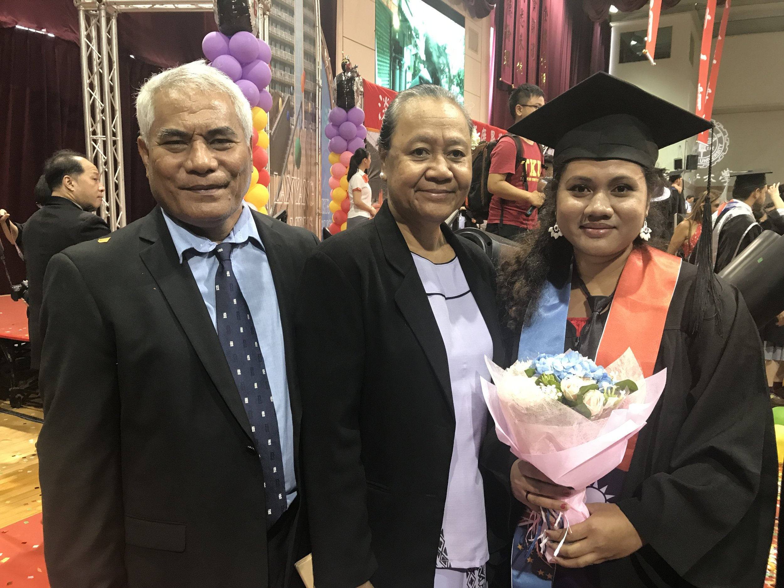 H.E. Ambassador Teatu and Mr. Siaeki Teatu with our graduate Ms. Akape Seu