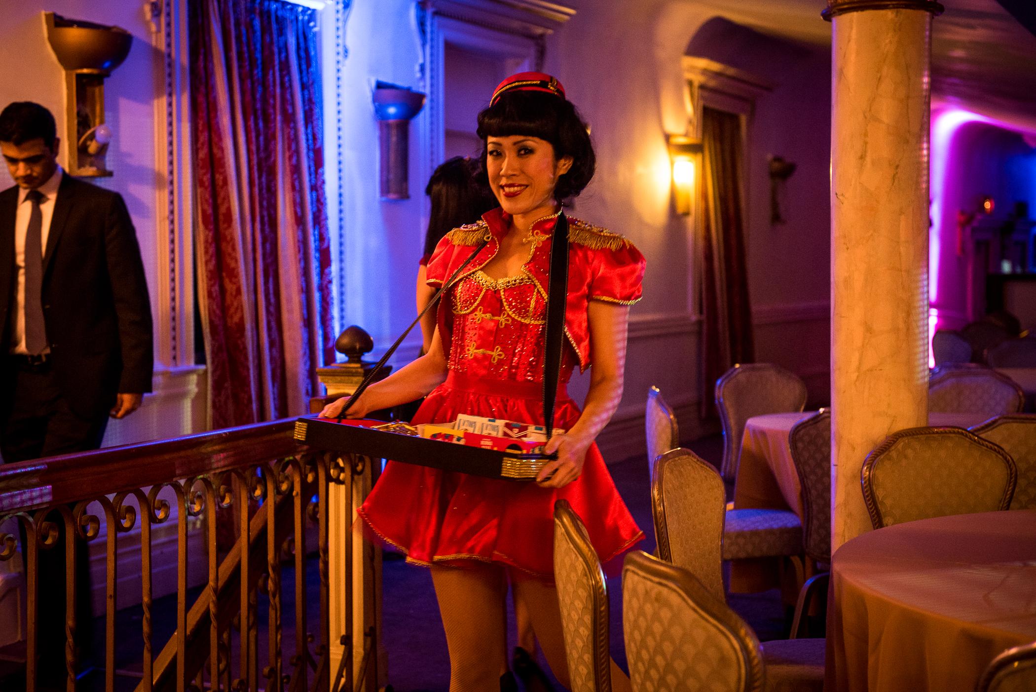 Vintage Red Cigarette Girl in Uniform